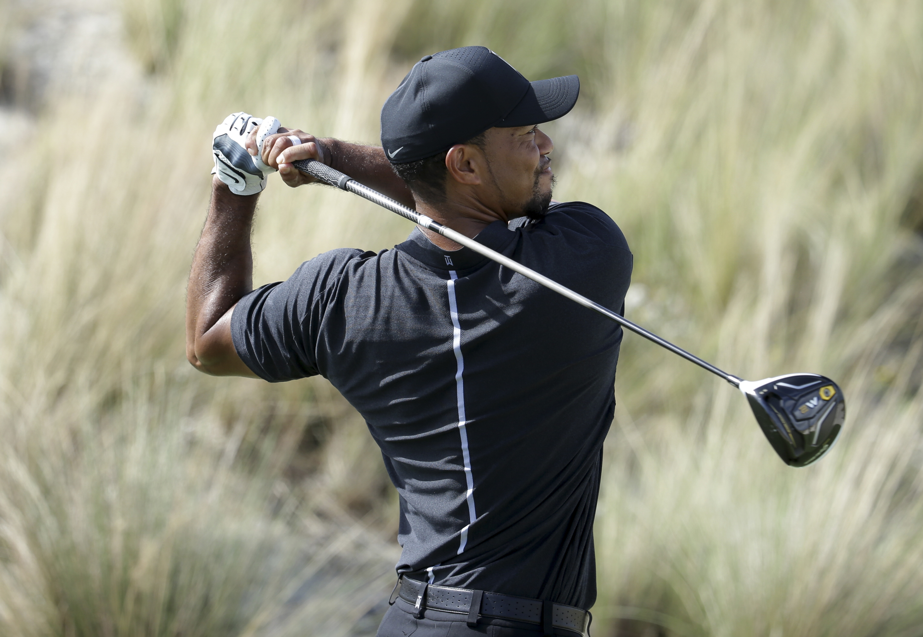 Tiger Woods watches his tee shot on the third hole during the first round at the Hero World Challenge golf tournament, Thursday, Dec. 1, 2016, in Nassau, Bahamas. (AP Photo/Lynne Sladky)