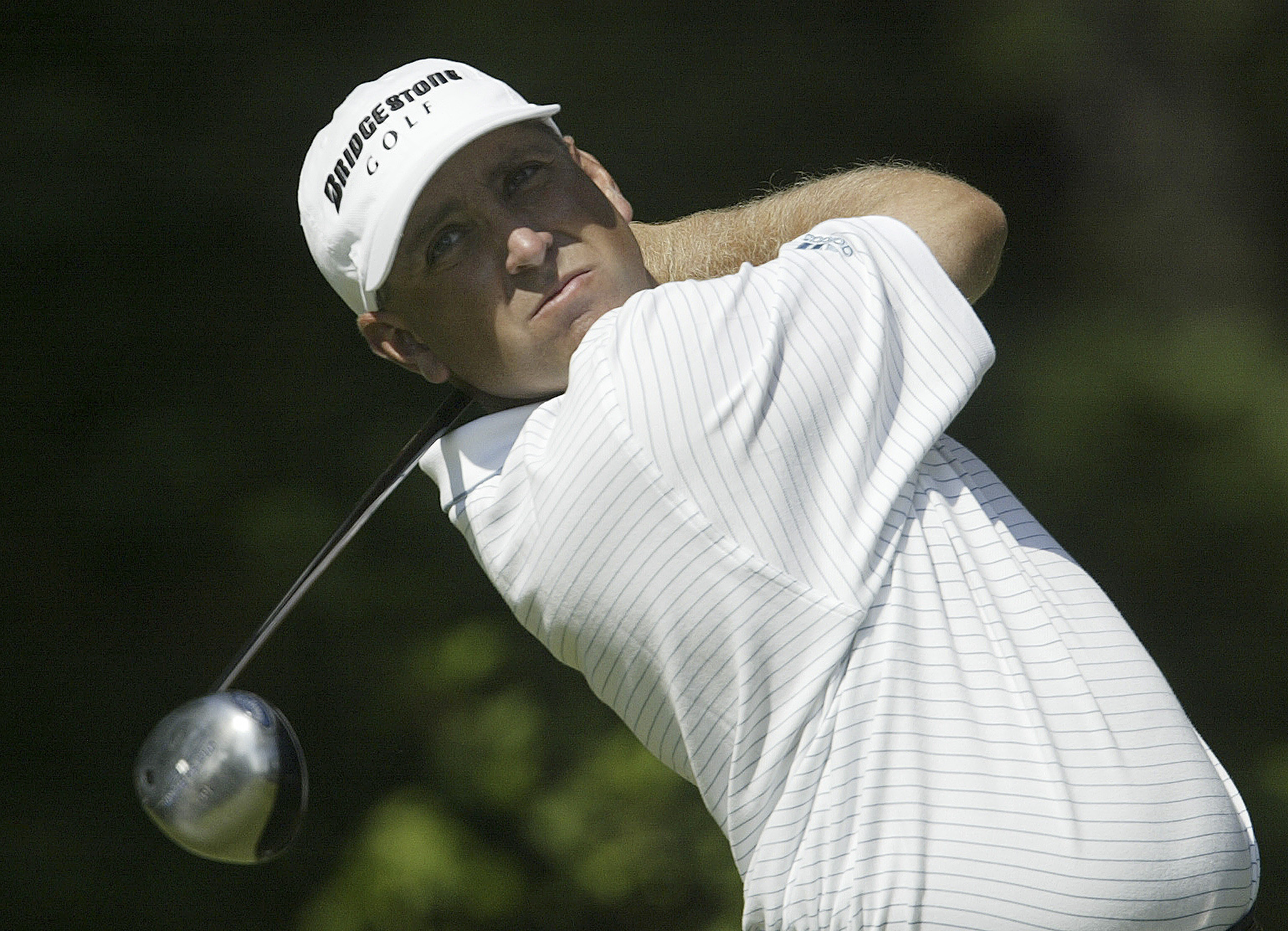 Scott Parel, from Augusta, Ga., tees off on the fourth hole during first round play in the 105th US Open Championship at the Pinehurst Resort and Country Club's No. 2 course in Pinehurst, N.C. Thursday, June 16, 2005. (AP Photo/Chuck Burton)