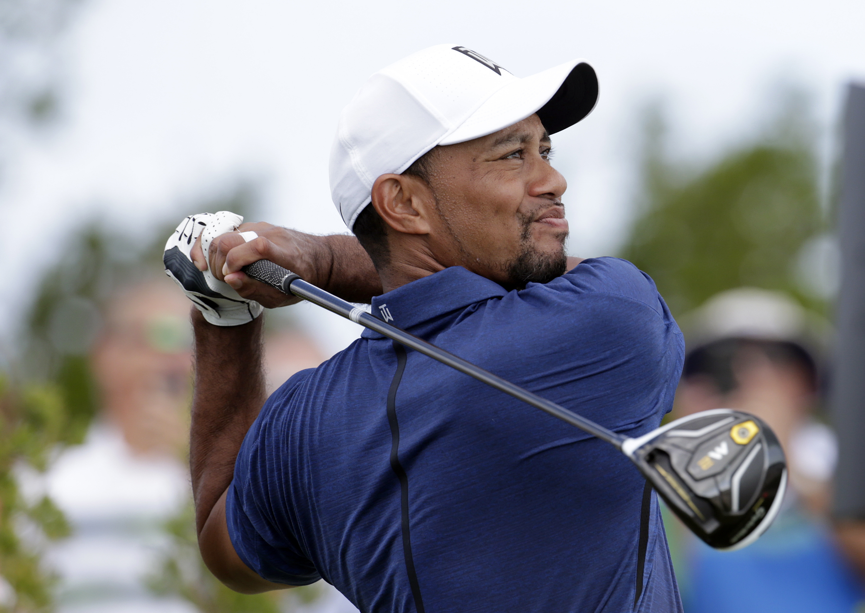 Tiger Woods watches his tee shot on the first hole during the second round at the Hero World Challenge golf tournament, Friday, Dec. 2, 2016, in Nassau, Bahamas. (AP Photo/Lynne Sladky)