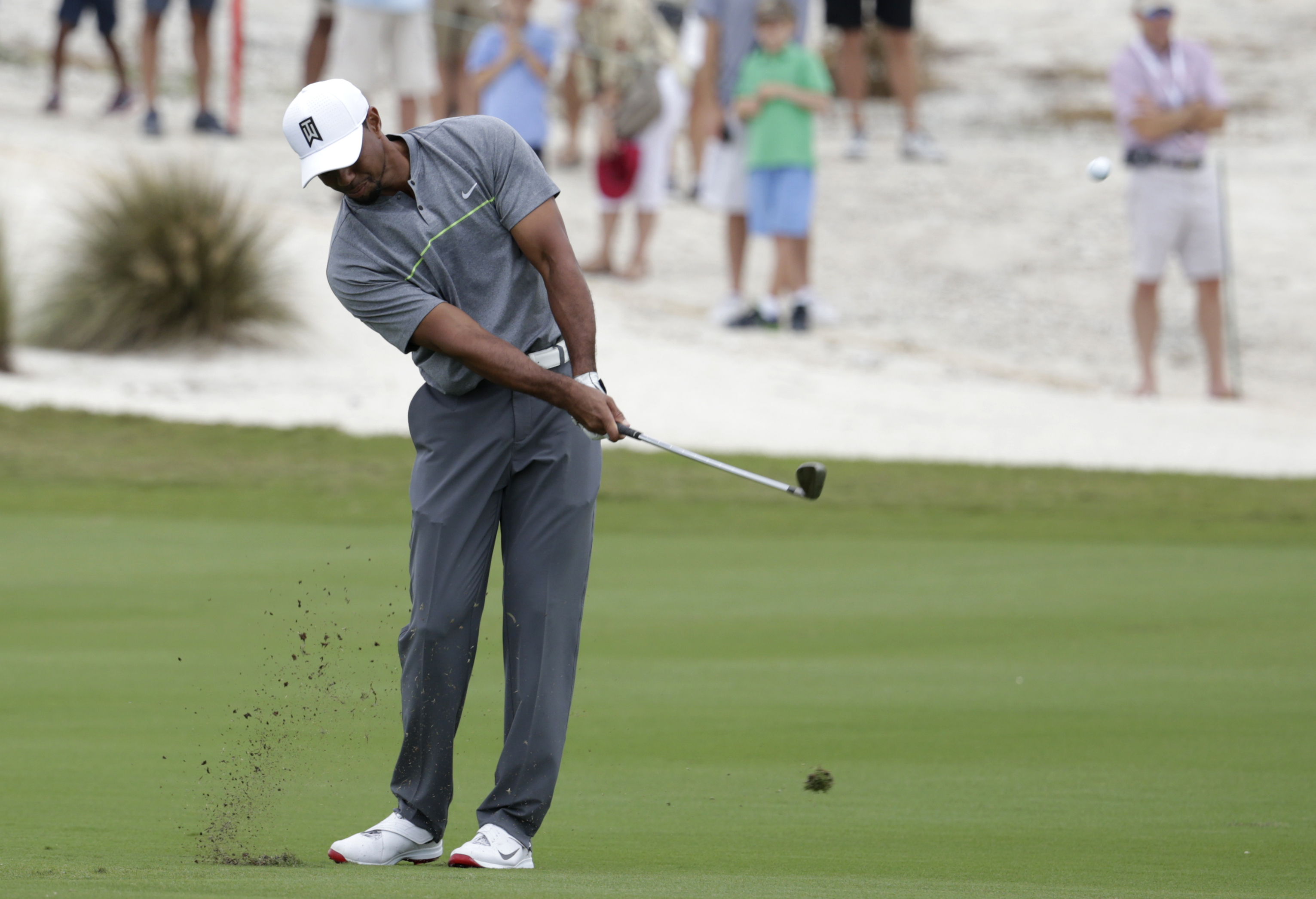 Tiger Woods hits from the first fairway during the third round at the Hero World Challenge golf tournament, Saturday, Dec. 3, 2016, in Nassau, Bahamas. (AP Photo/Lynne Sladky)