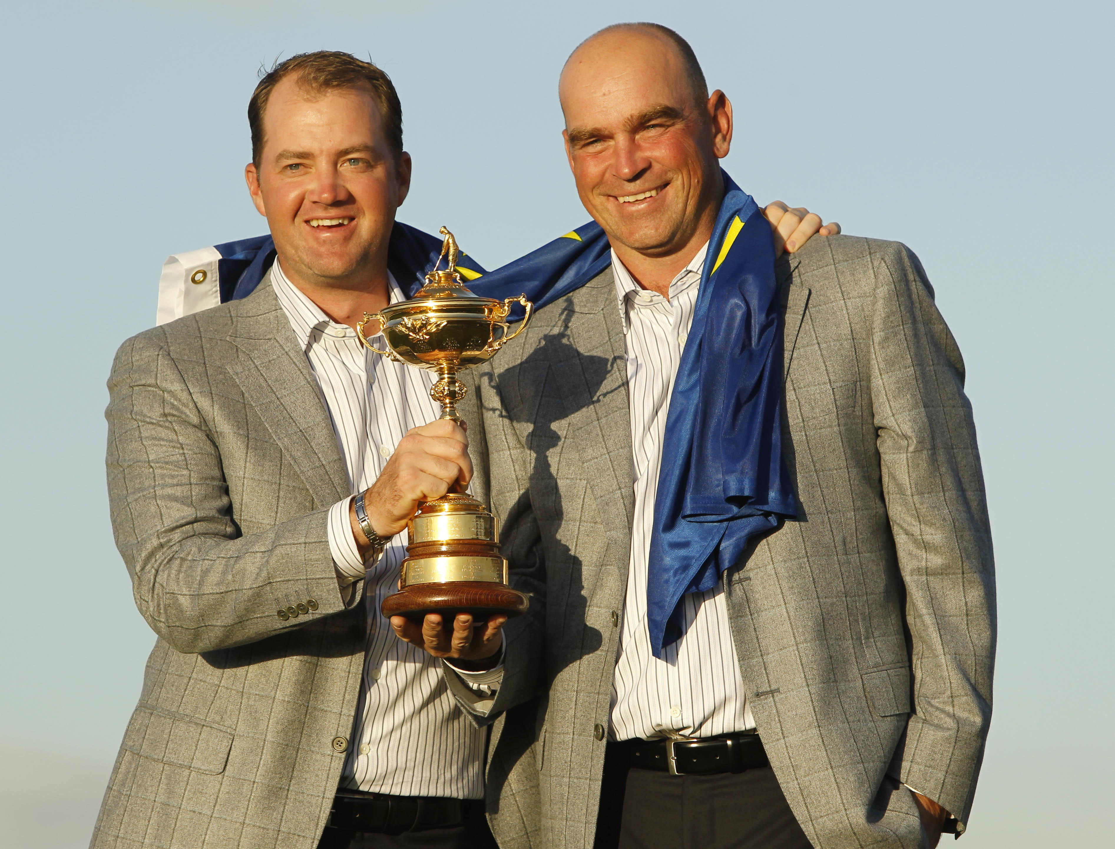 FILE - In this Monday, Oct. 4, 2010 file photo, Europe's Peter Hanson, left, and assistant captain Thomas Bjorn hold the trophy after Europe won the 2010 Ryder Cup golf tournament at the Celtic Manor Resort in Newport, Wales. Bjorn is the first Scandinavi