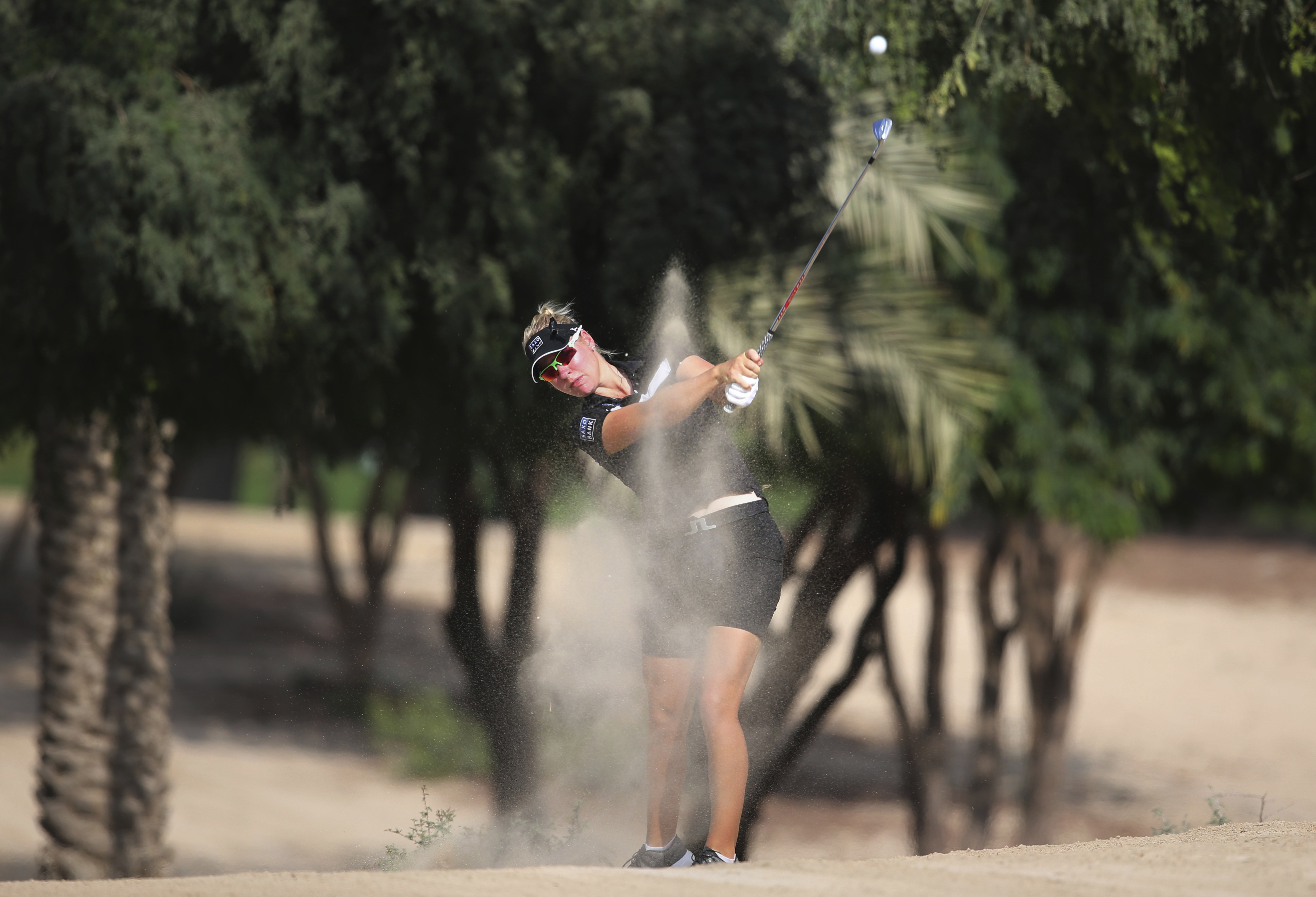 Nicole Broch Larsen of Denmark plays a shot on the 14th hole during the Revised 1st round of Dubai Ladies Masters golf tournament in Dubai, United Arab Emirates, Thursday, Dec. 8, 2016. (AP Photo/Kamran Jebreili)