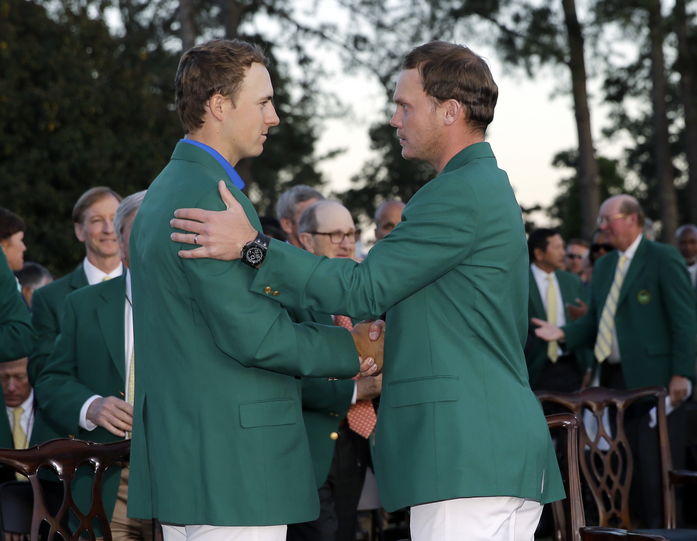 FILE- In this April 10, 2016 file photo, defending champion Jordan Spieth, left, shakes hands with Masters champion Danny Willett, of England, following the final round of the Masters golf tournament in Augusta, Ga. After making a run at the Grand Slam in