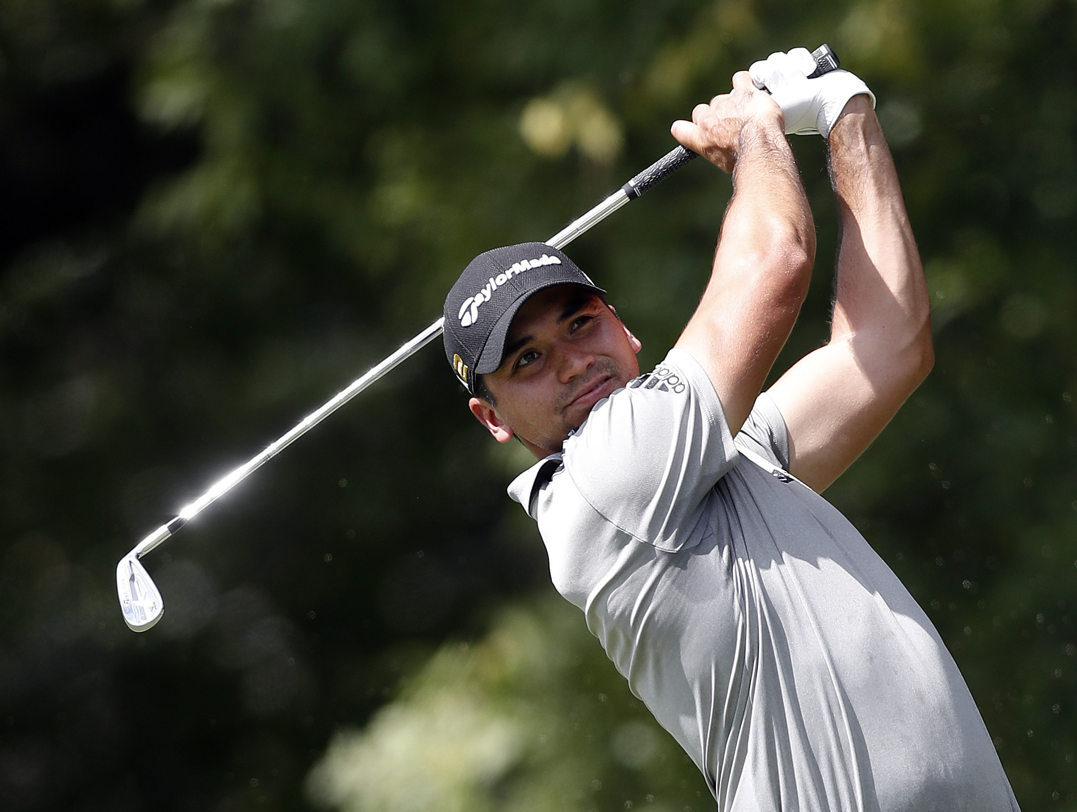 FILE - In this Sept. 23, 2016, file photo, Jason Day hits from the tee on the second hole during the second round of play at the Tour Championship golf tournament at East Lake Golf Club in Atlanta.  The world's No. 1 player hasn't been seen since he withd