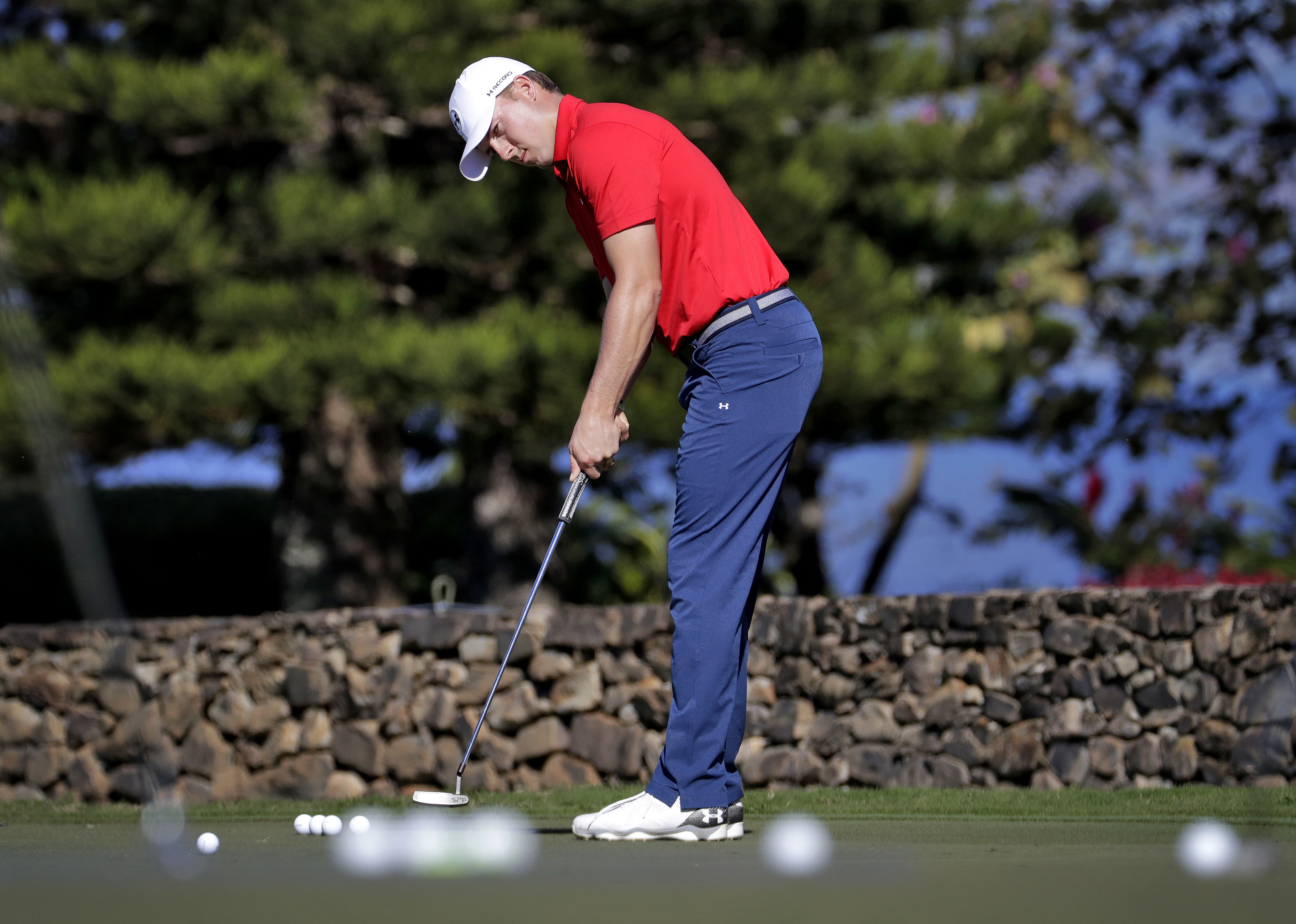 Defending champion Jordan Spieth practices on the putting green prior to the Tournament of Champions golf event, Wednesday, Jan. 4, 2017, at Kapalua Plantation Course in Kapalua, Hawaii. (AP Photo/Matt York)