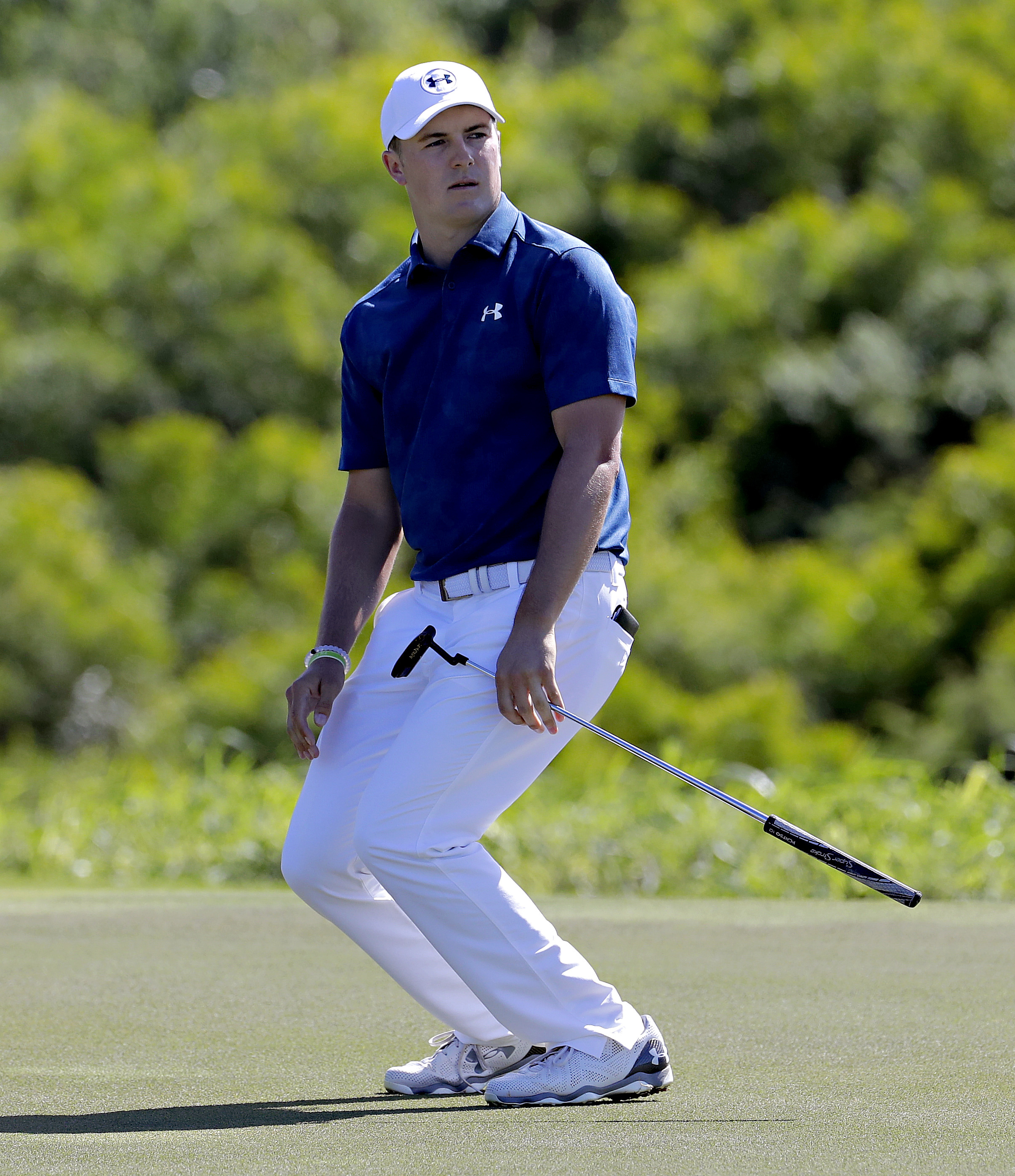 Jordan Spieth reacts to a missed birdie putt on the 17th green during the final round of the Tournament of Champions golf event, Sunday, Jan. 8, 2017, at Kapalua Plantation Course in Kapalua, Hawaii. (AP Photo/Matt York)