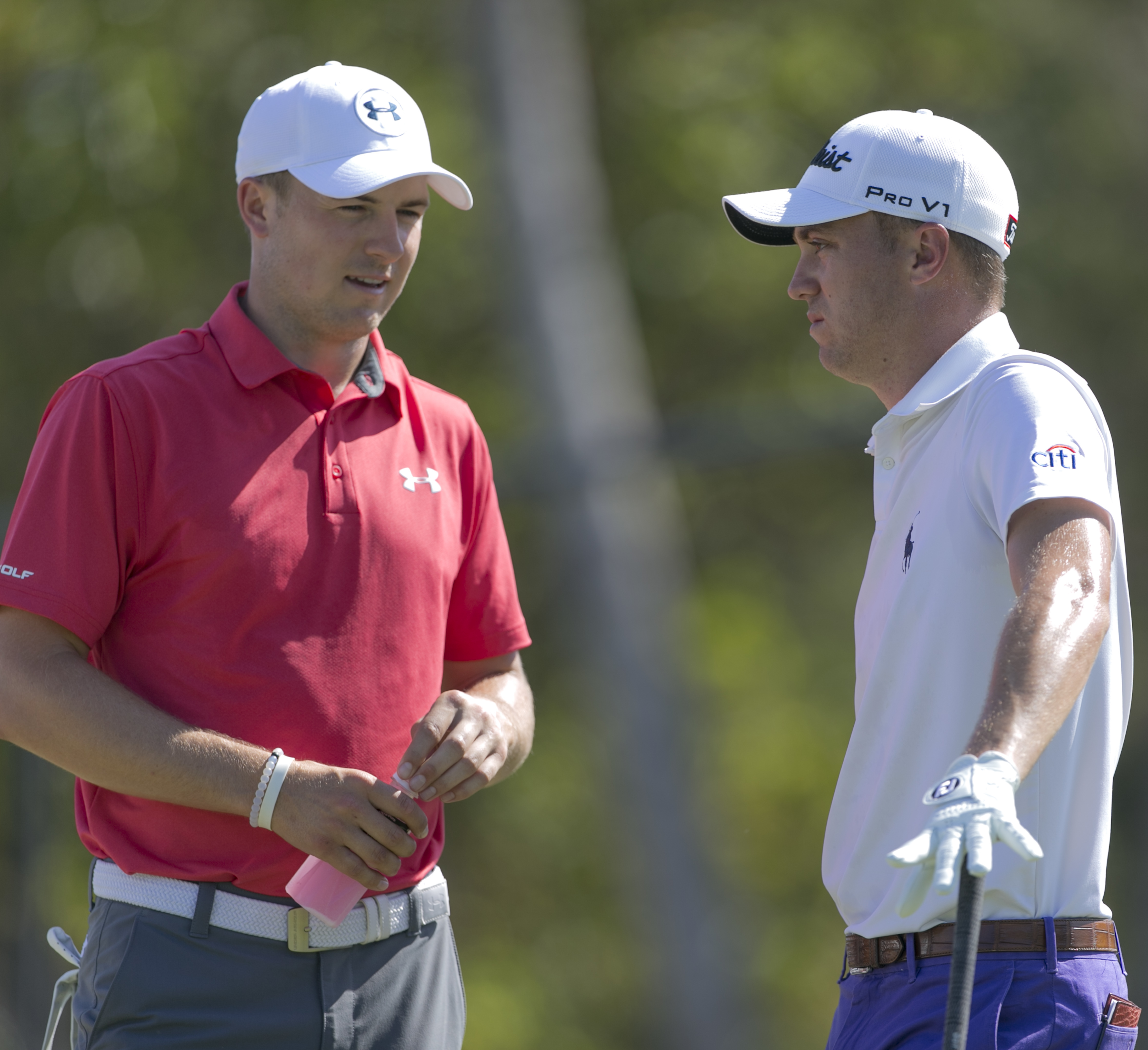 Jordan Spieth, left, and Justin Thomas chat before their second round at the Sony Open golf tournament, Friday, Jan. 13, 2017, in Honolulu. (AP Photo/Marco Garcia)