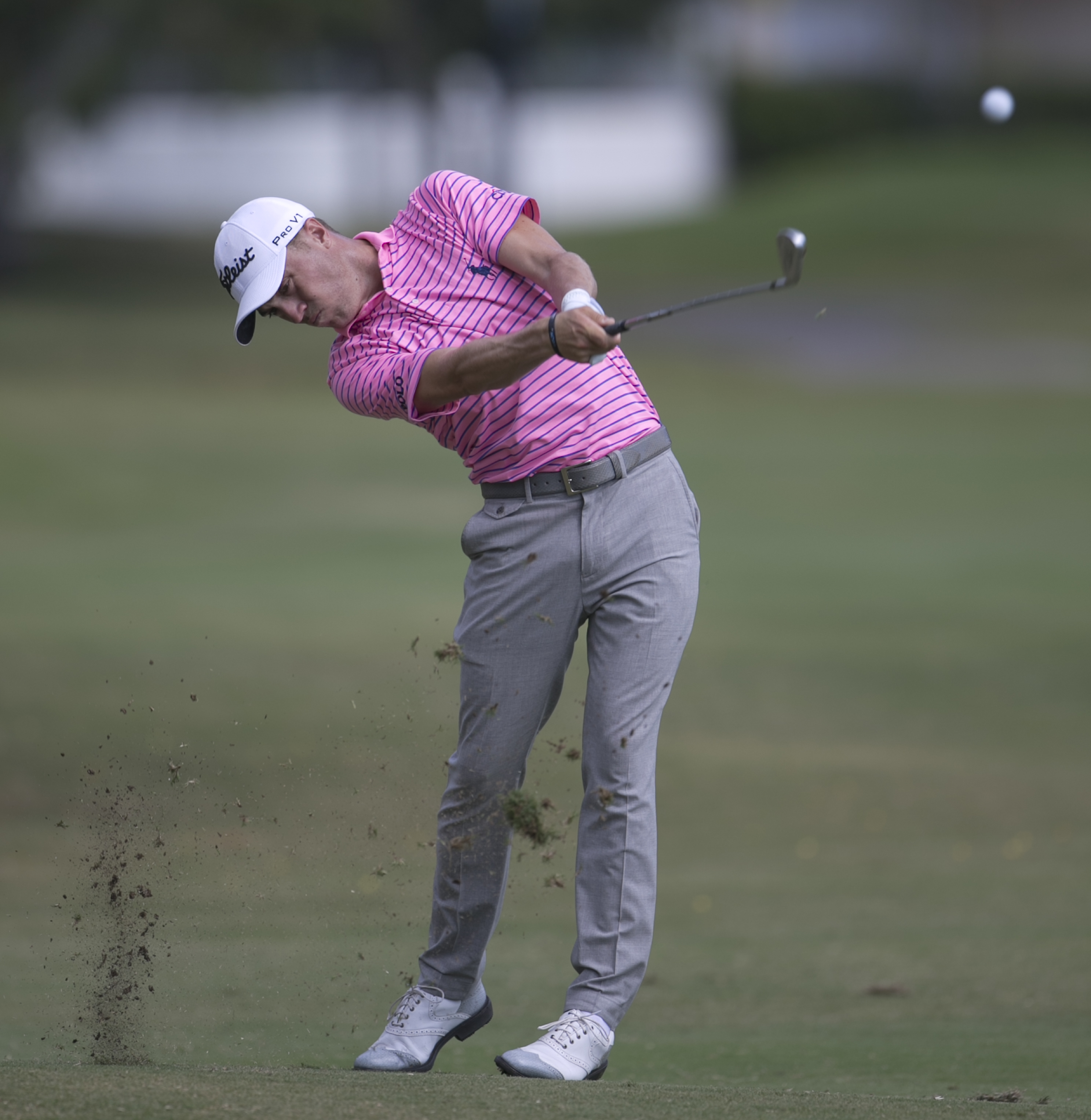 Justin Thomas hits his ball off the third fairway during the third round of the Sony Open golf tournament, Saturday, Jan. 14, 2017, in Honolulu. (AP Photo/Marco Garcia)
