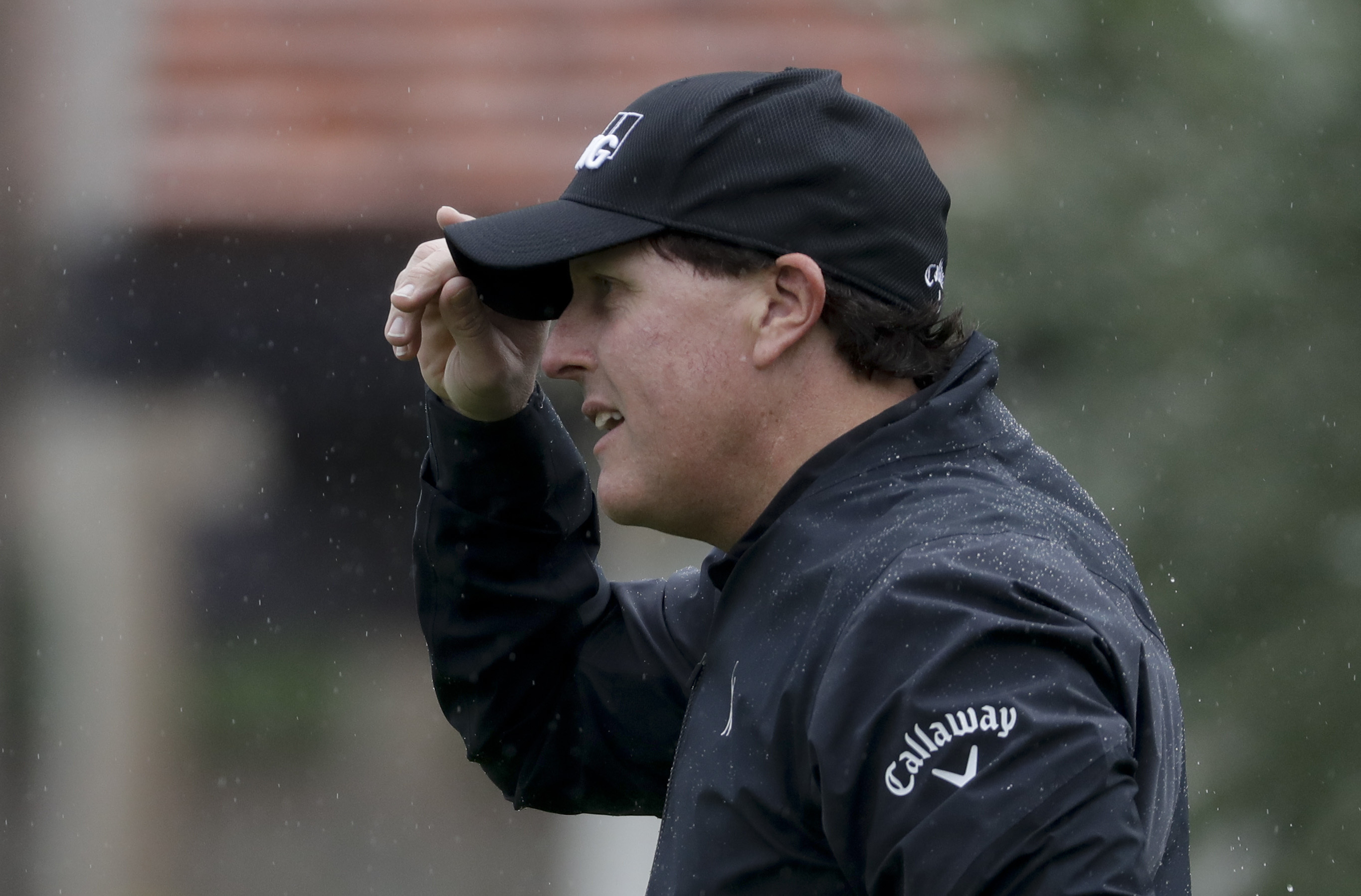 Phil Mickelson reacts after making a putt on the third hole during the first round of the CareerBuilder Challenge at the La Quinta County Club Thursday, Jan. 19, 2017 in La Quinta, Calif. (AP Photo/Chris Carlson)