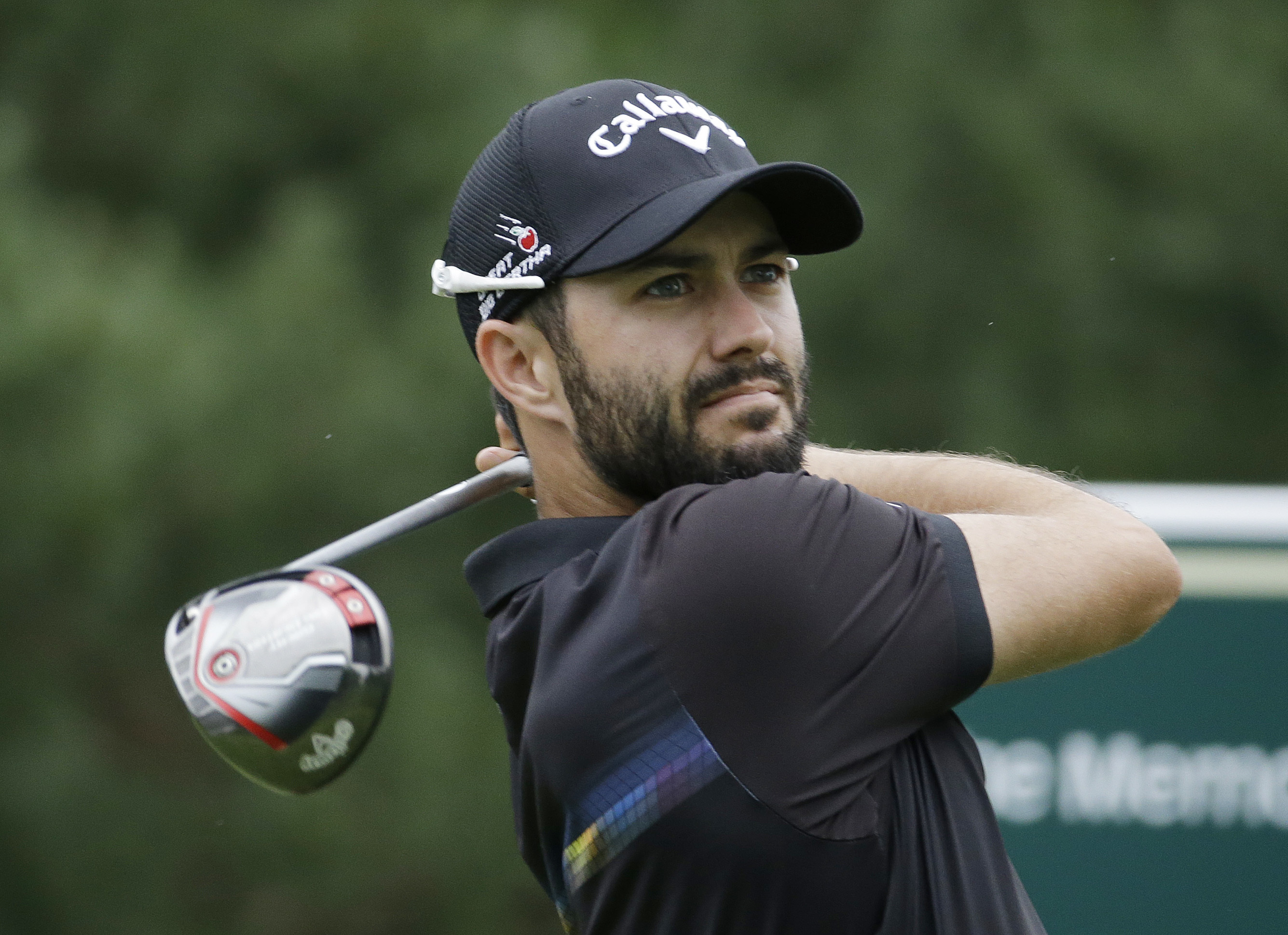 Adam Hadwin, of Canada, watches his tee shot off the 15th hole during the third round of the Memorial golf tournament, Saturday, June 4, 2016, in Dublin, Ohio. (AP Photo/Darron Cummings)