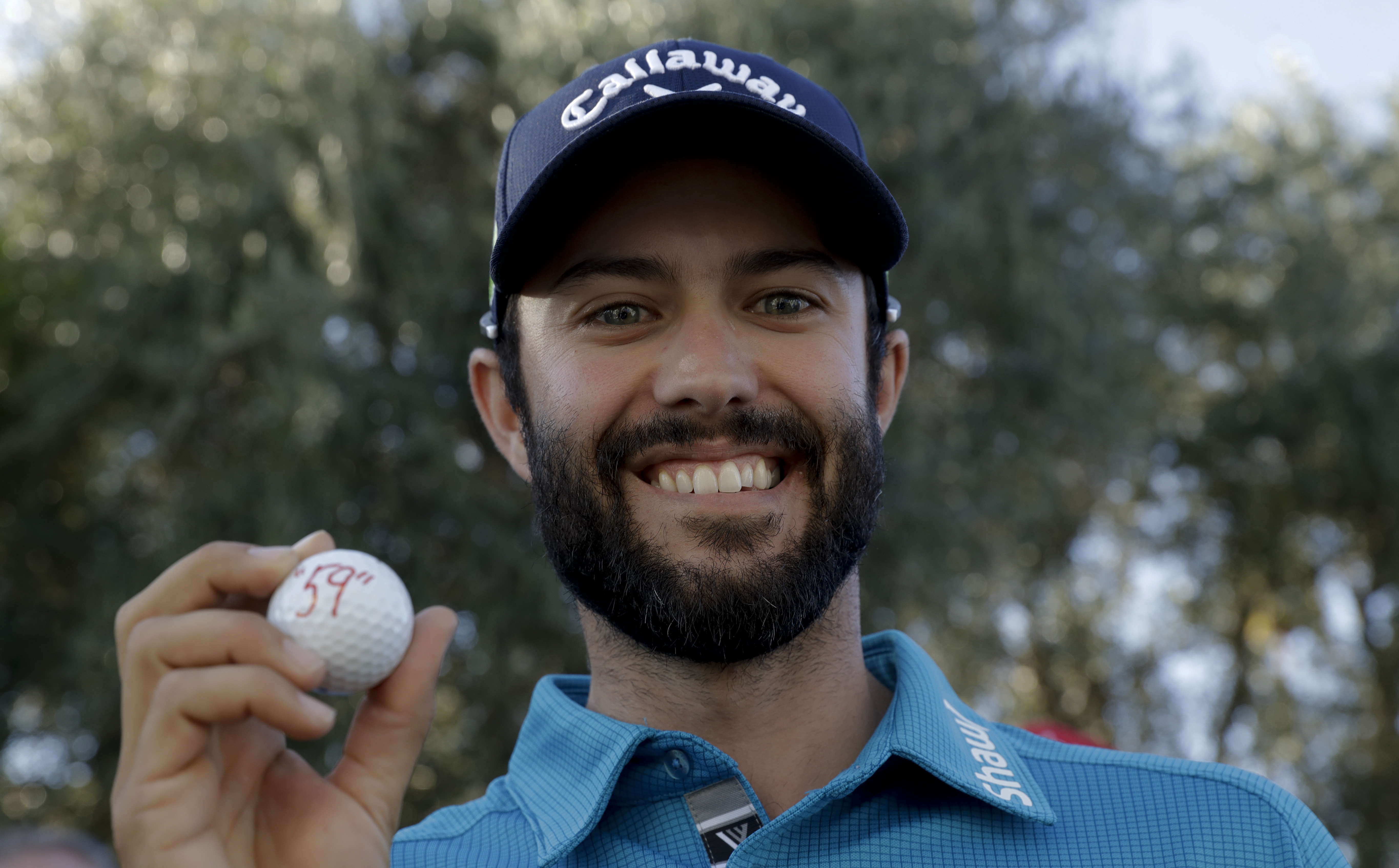 Adam Hadwin celebrates poses after shooting a 59 to take the third round lead in the CareerBuilder Challenge golf tournament at La Quinta Country Club Saturday, Jan. 21, 2017, in La Quinta, Calif. (AP Photo/Chris Carlson)