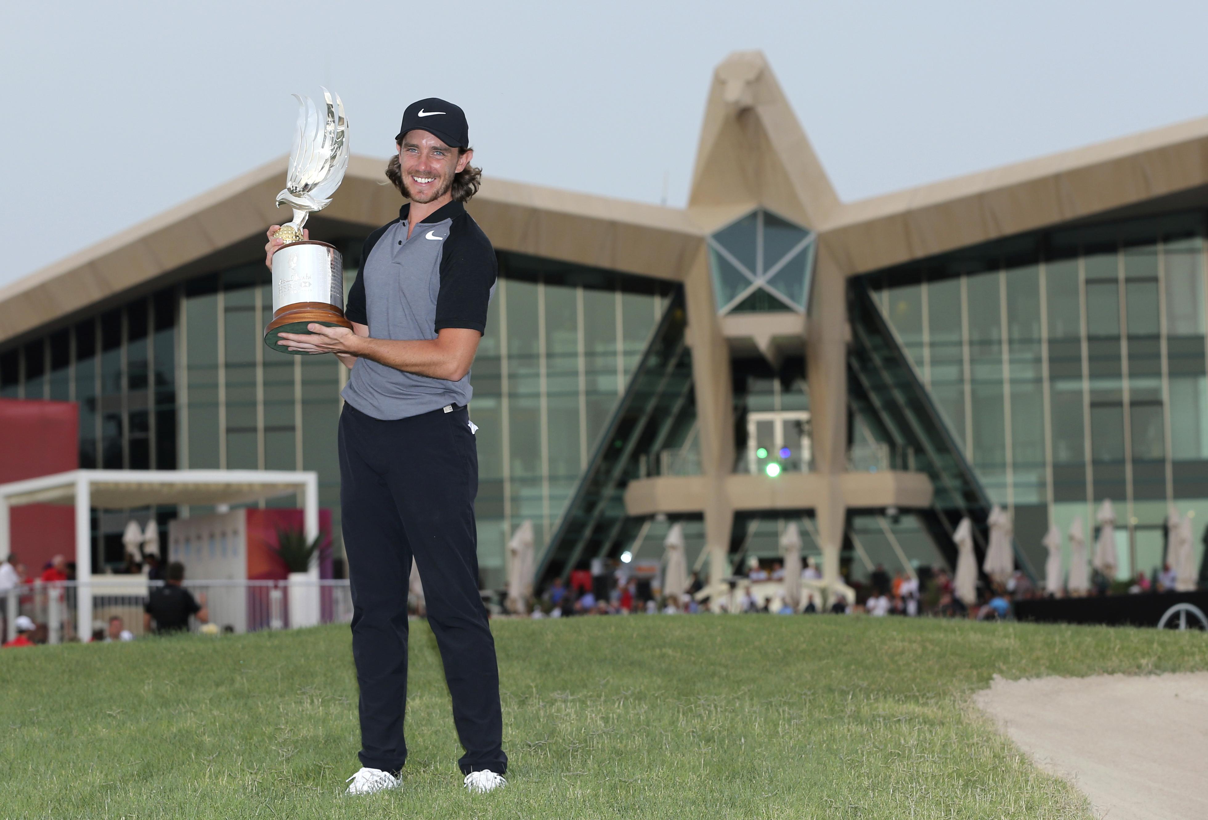 Tommy Fleetwood of England holds the trophy after he won the Abu Dhabi Golf Championship, in Abu Dhabi, United Arab Emirates, Sunday, Jan. 22, 2017. (AP Photo/Kamran Jebreili)