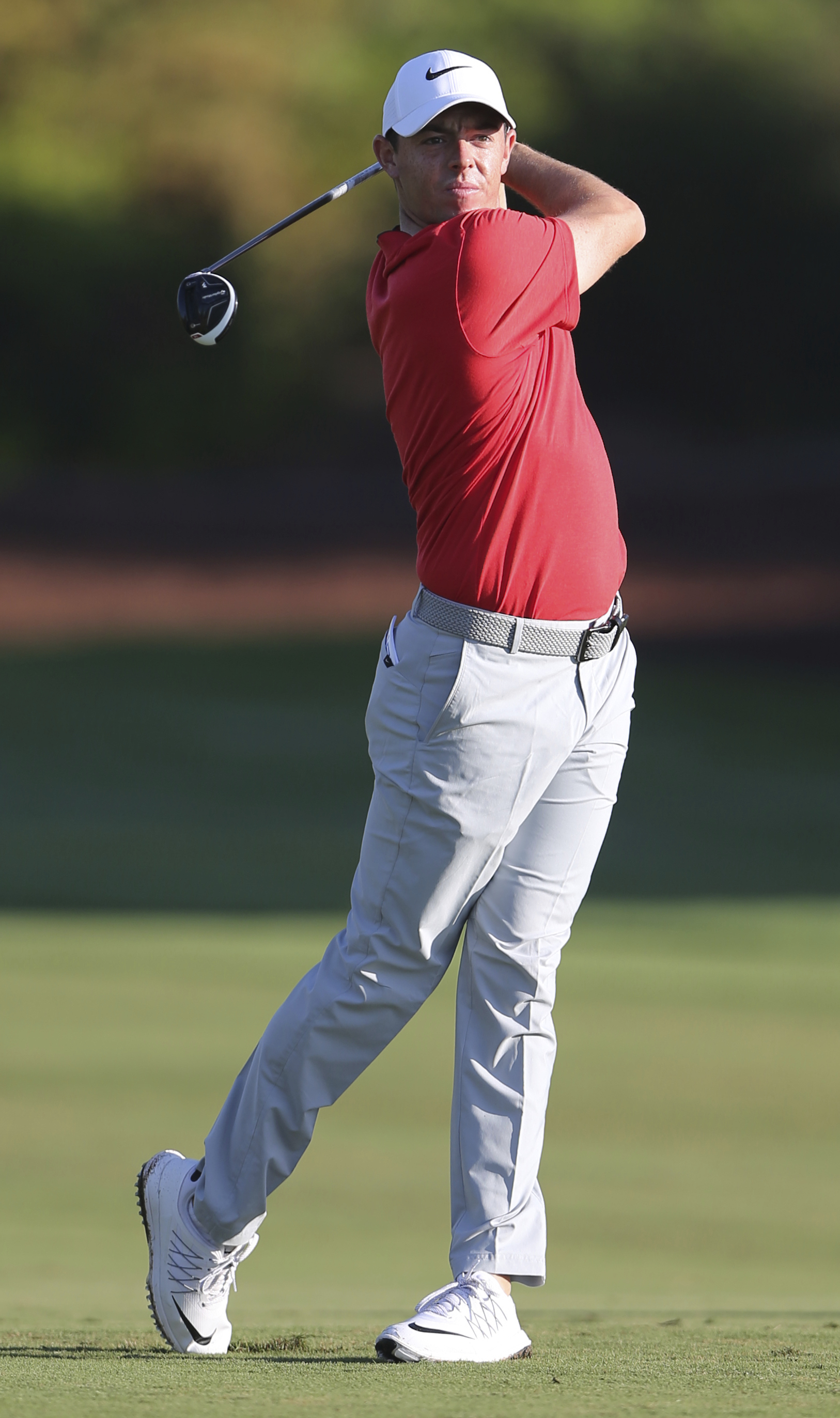 FILE - In this file photo dated Friday, Nov. 18, 2016, Rory McIlroy of Northern Ireland plays a shot on the 2nd hole during the 2nd round of the DP World Tour Championship golf tournament in Dubai, United Arab Emirates. McIlroy has said Tuesday Jan. 24, 2