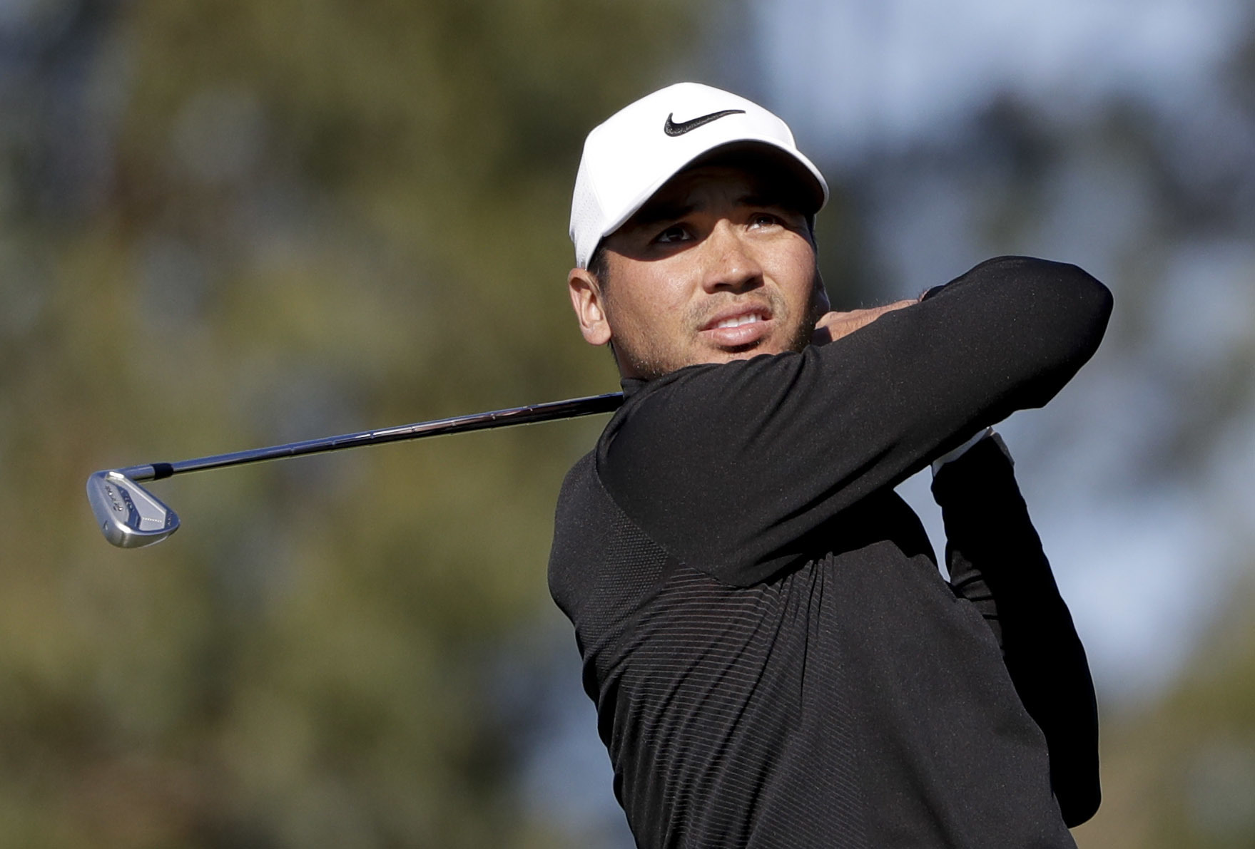 Jason Day, of Australia, watches his tee shot on the eighth hole of the North Course during the second round of the Farmers Insurance Open golf tournament Friday, Jan. 27, 2017, at Torrey Pines Golf Course in San Diego. (AP Photo/Gregory Bull)