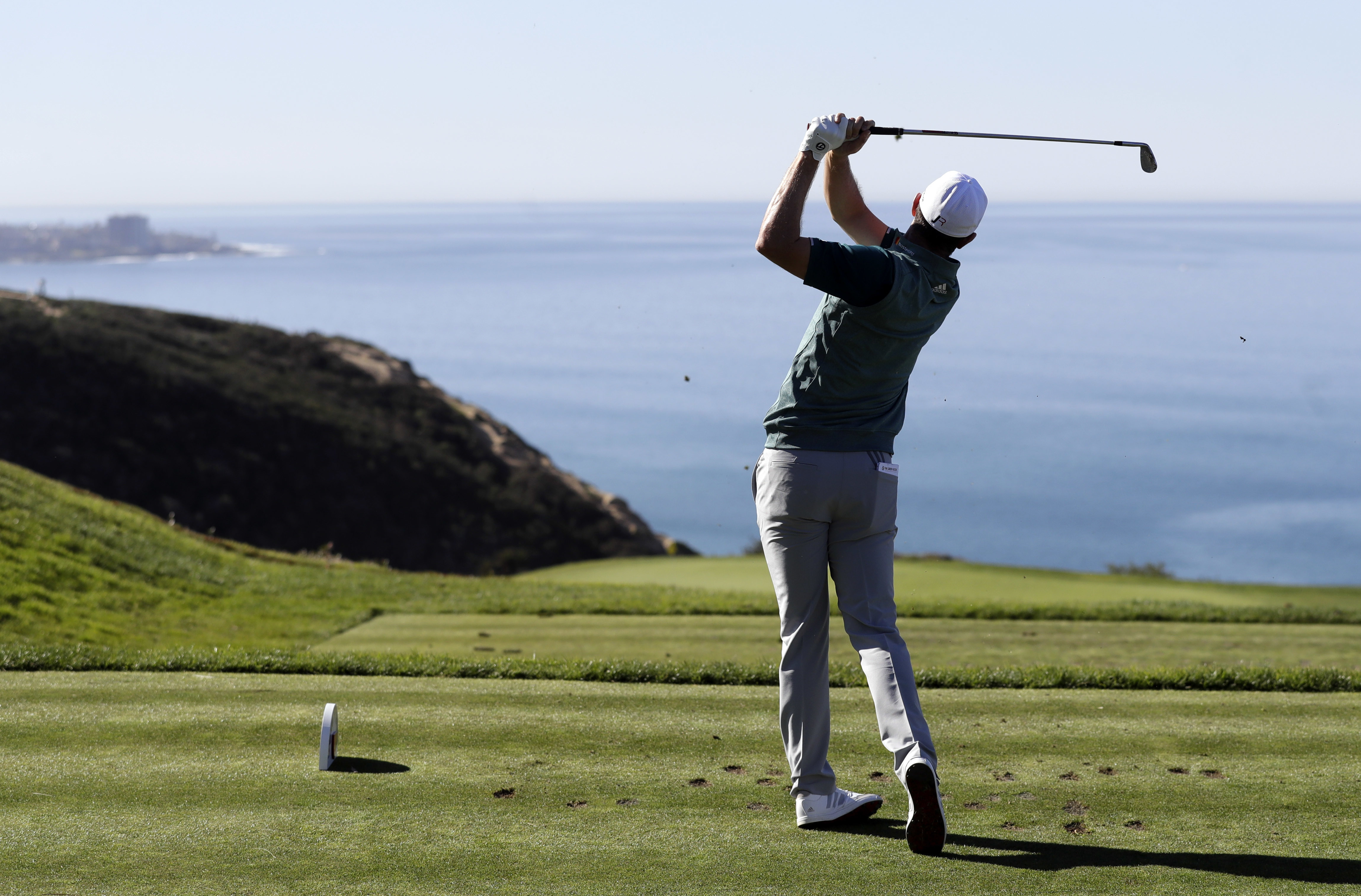 Justin Rose, of England, watches his tee shot on the third hole of the South Course during the third round of the Farmers Insurance Open golf tournament Saturday, Jan. 28, 2017, at Torrey Pines Golf Course in San Diego. (AP Photo/Gregory Bull)