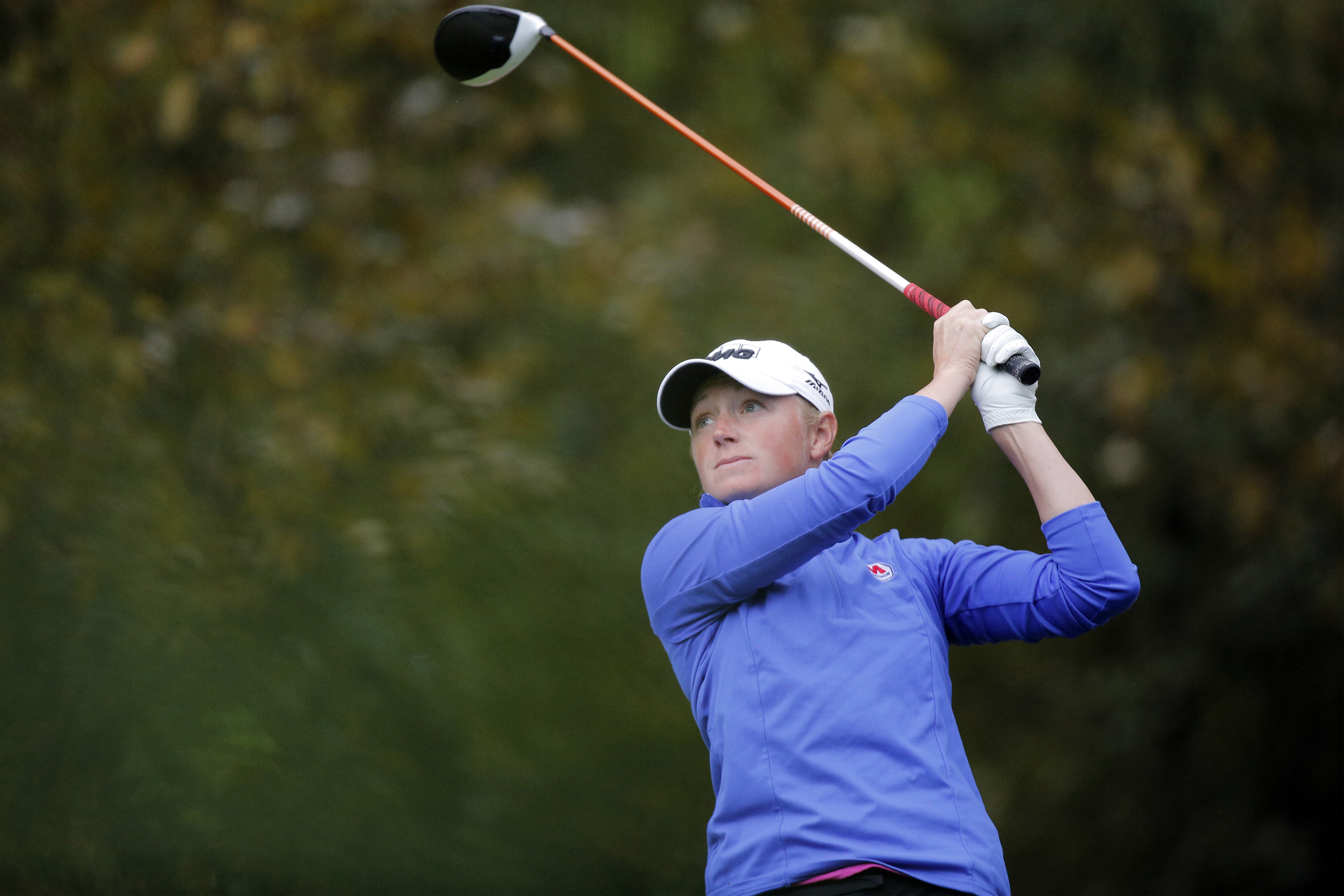 Stacy Lewis, of US, follows her ball after playing on the 14th hole during the second round of the Evian Championship women's golf tournament in Evian, eastern France, Friday, Sept. 16, 2016. (AP Photo/Laurent Cipriani)