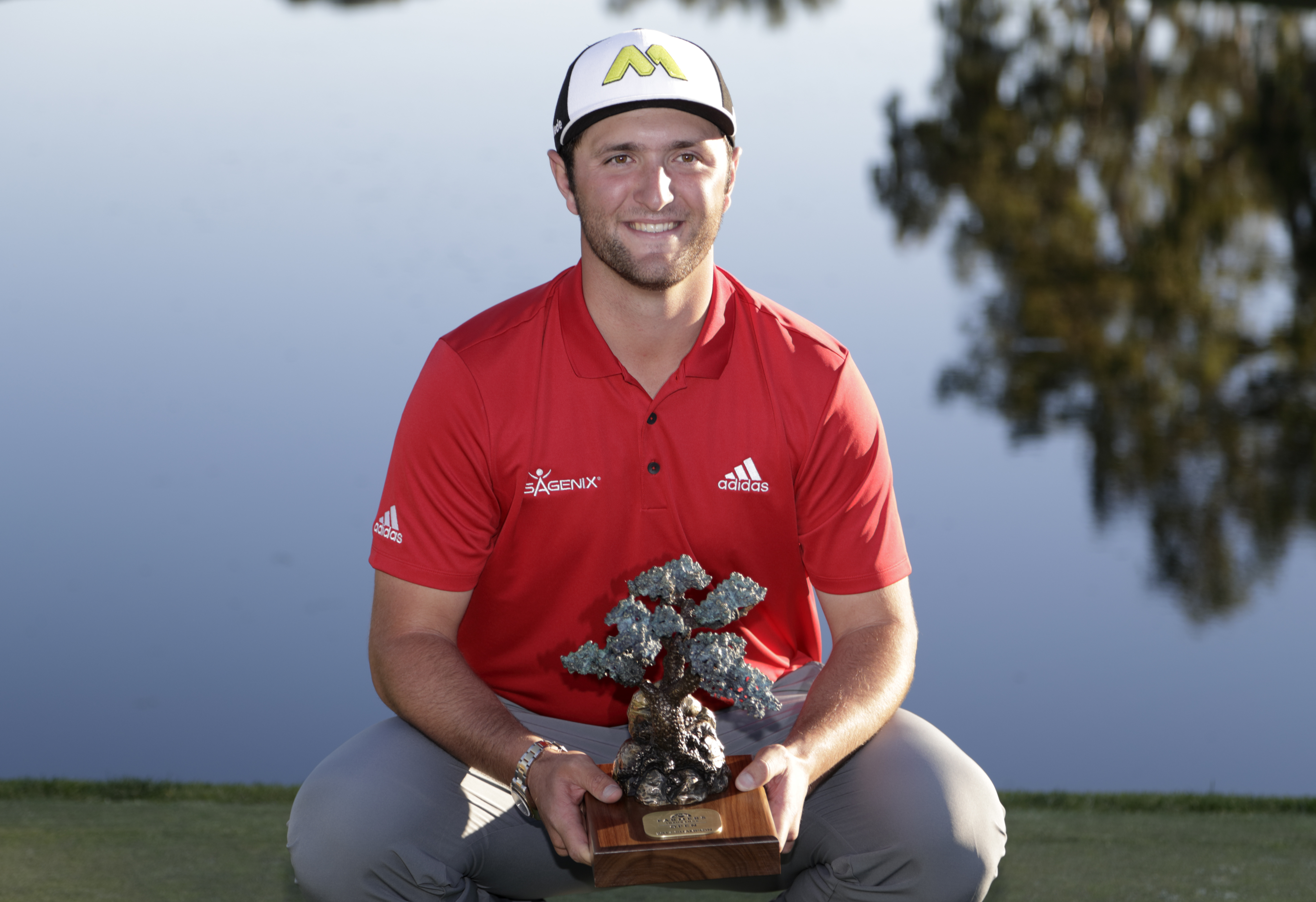 Jon Rahm, of Spain, holds the trophy after winning the Farmers Insurance Open golf tournament Sunday, Jan. 29, 2017, at Torrey Pines Golf Course in San Diego. (AP Photo/Gregory Bull)