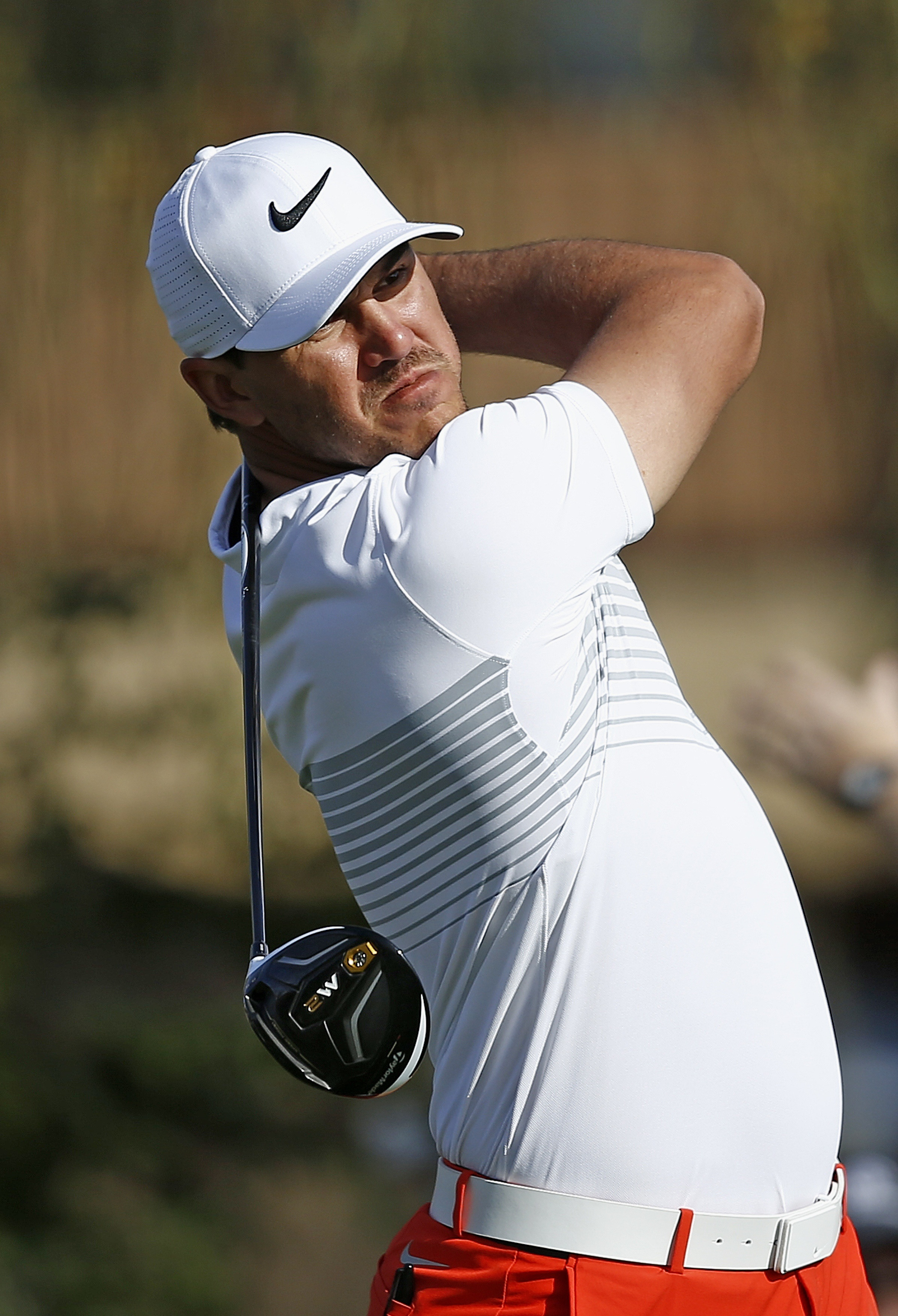 Brooks Koepka hits his tee shot on the second hole during the first round of the Waste Management Phoenix Open golf tournament Thursday, Feb. 2, 2017, in Scottsdale, Ariz. (AP Photo/Ross D. Franklin)