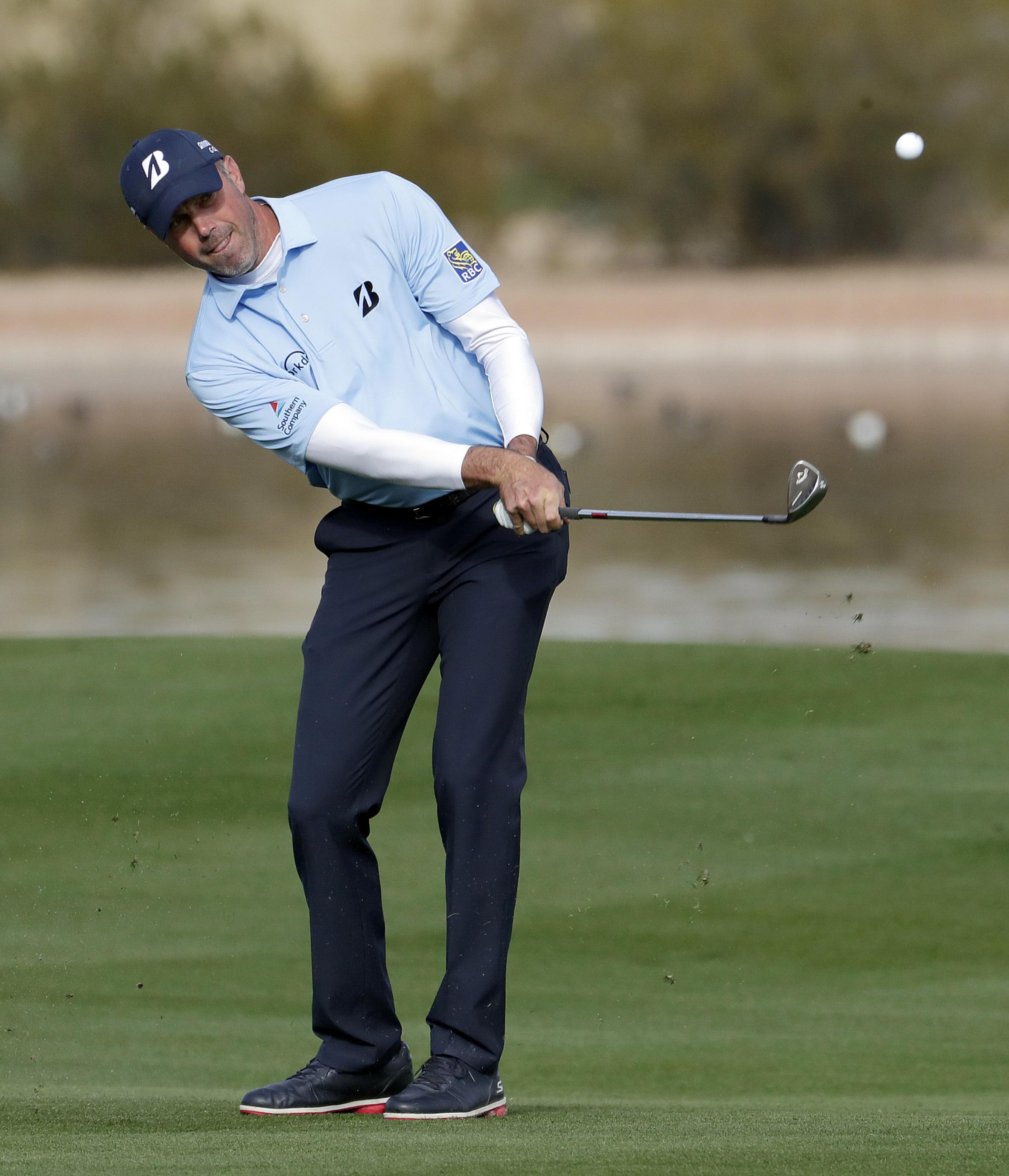 Matt Kucher hits his second shot from the 15th fairway during the second round of the Phoenix Open golf tournament, Friday, Feb. 3, 2017, in Scottsdale, Ariz. (AP Photo/Matt York)