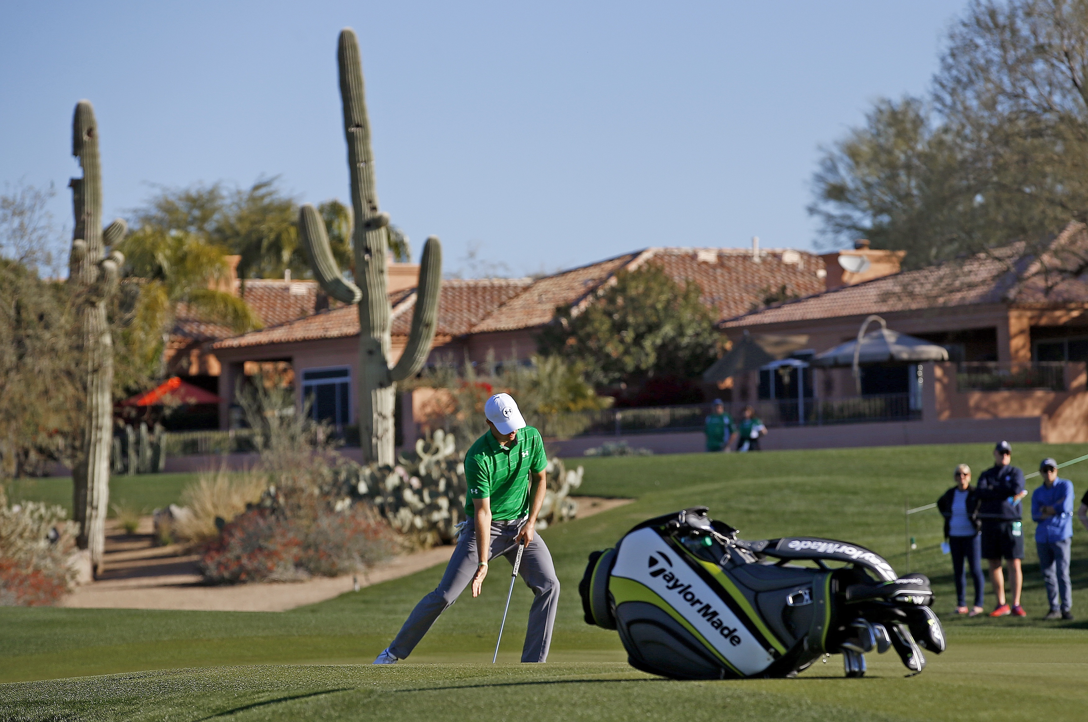Jordan Spieth tries to coax a putt on the second hole during the third round of the Waste Management Phoenix Open golf tournament Saturday, Feb. 4, 2017, in Scottsdale, Ariz. (AP Photo/Ross D. Franklin)