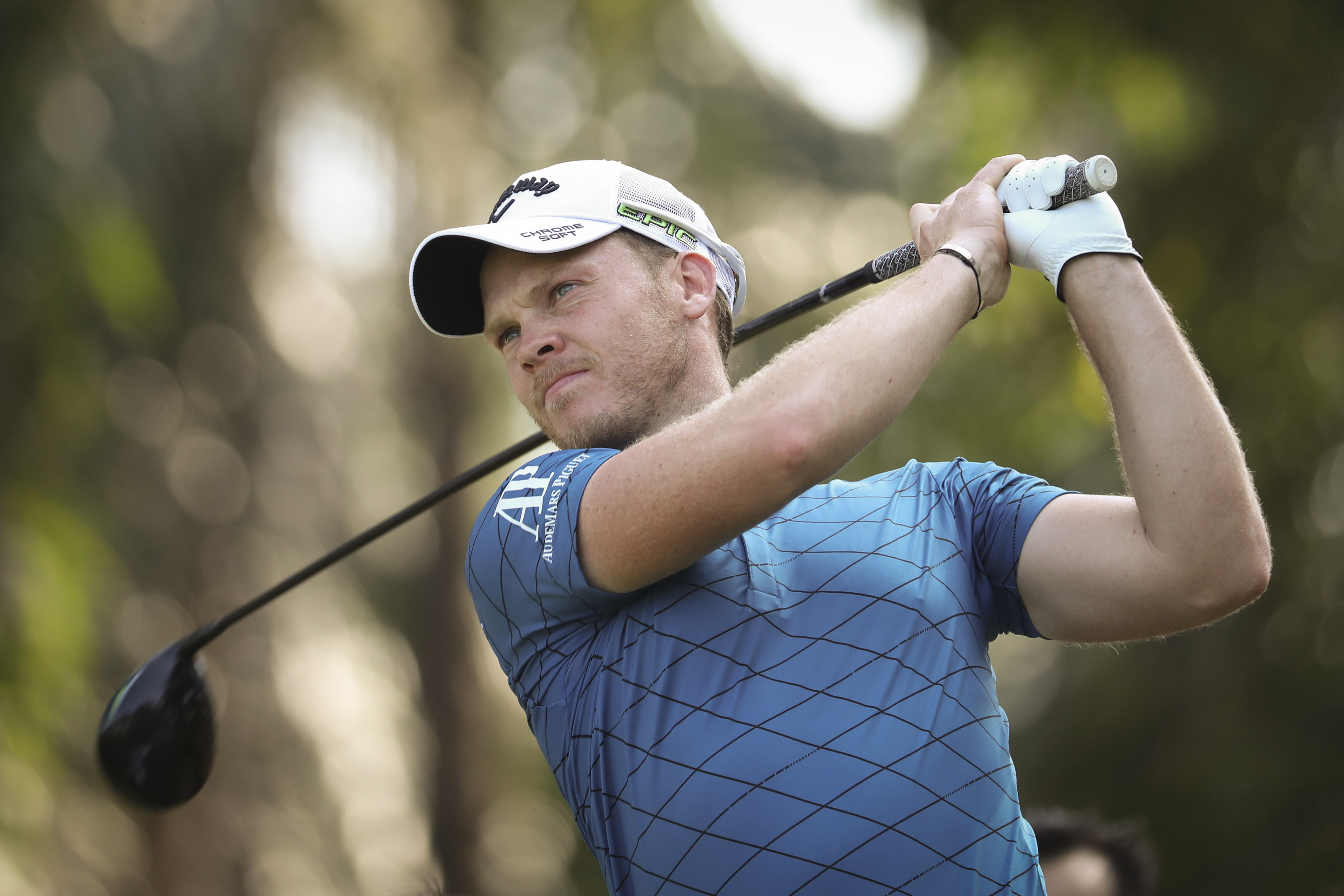 Danny Willet of England follows his shot on the sixteenth hole during the first day of Maybank Championship golf tournament in Kuala Lumpur, Malaysia on Thursday, Feb. 9, 2017. (AP Photo/Vincent Thian)