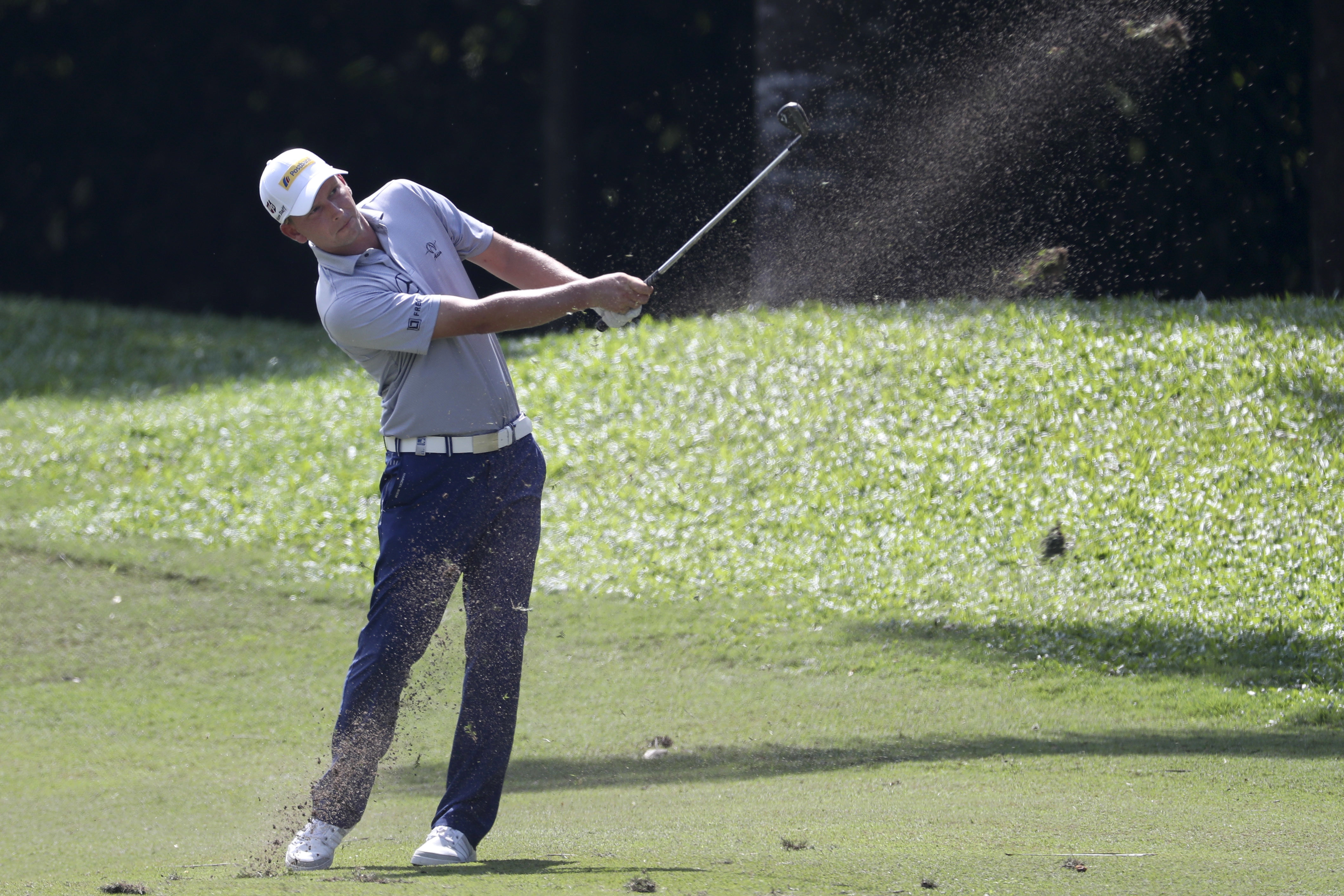 Germany's Marcel Siem follow his shot on the 15th hole during the second day of Maybank Championship golf tournament in Kuala Lumpur, Malaysia, Friday, Feb. 10, 2017. (AP Photo/Daniel Chan)