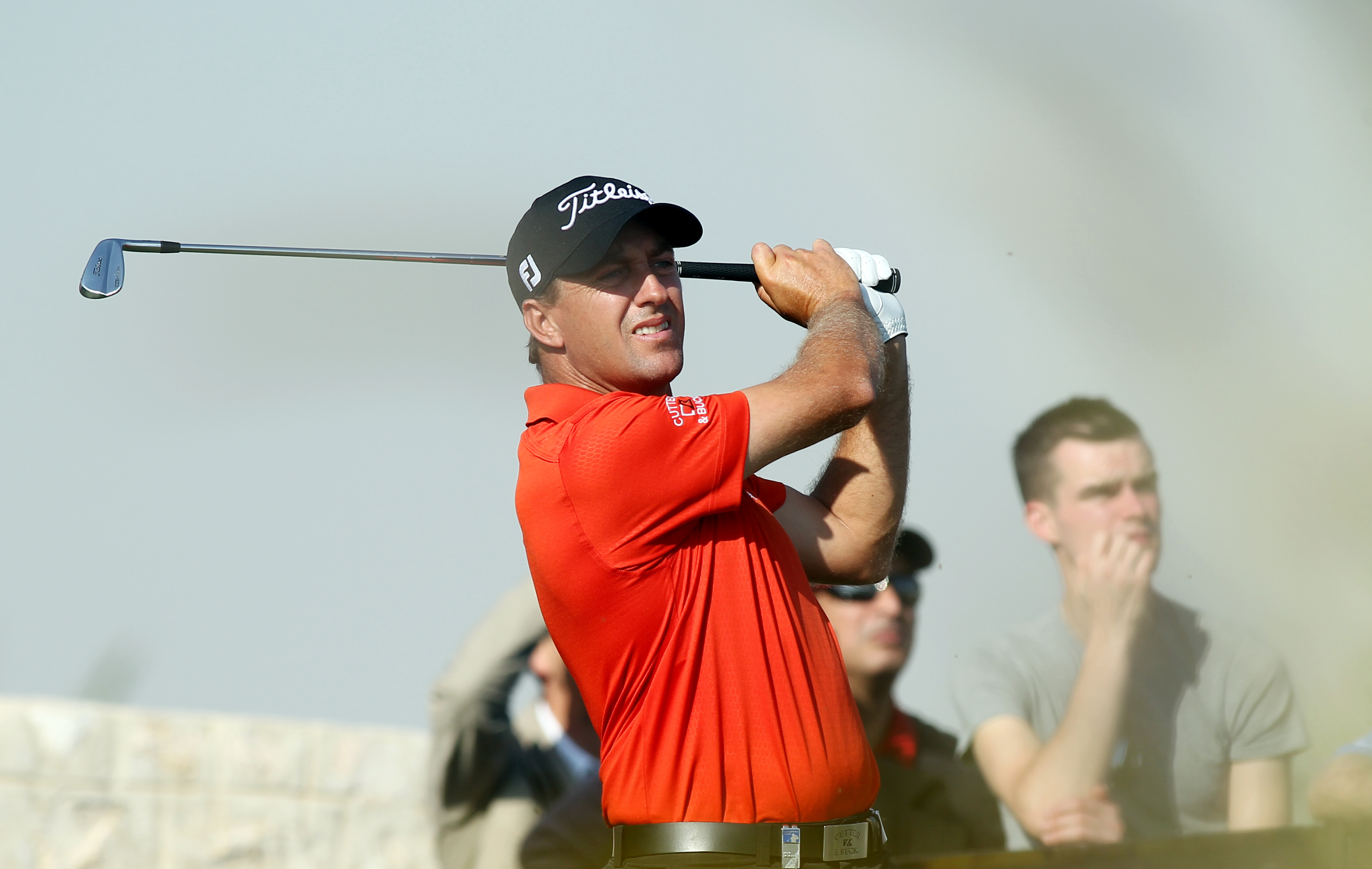 Darren Fichardt of South Africa  hits his tee shot on the ninth hole during the second round of the Commercial Bank Qatar Masters at the Doha Golf Club in Doha, Qatar, Thursday, Jan. 23, 2014. (AP Photo/Osama Faisal)