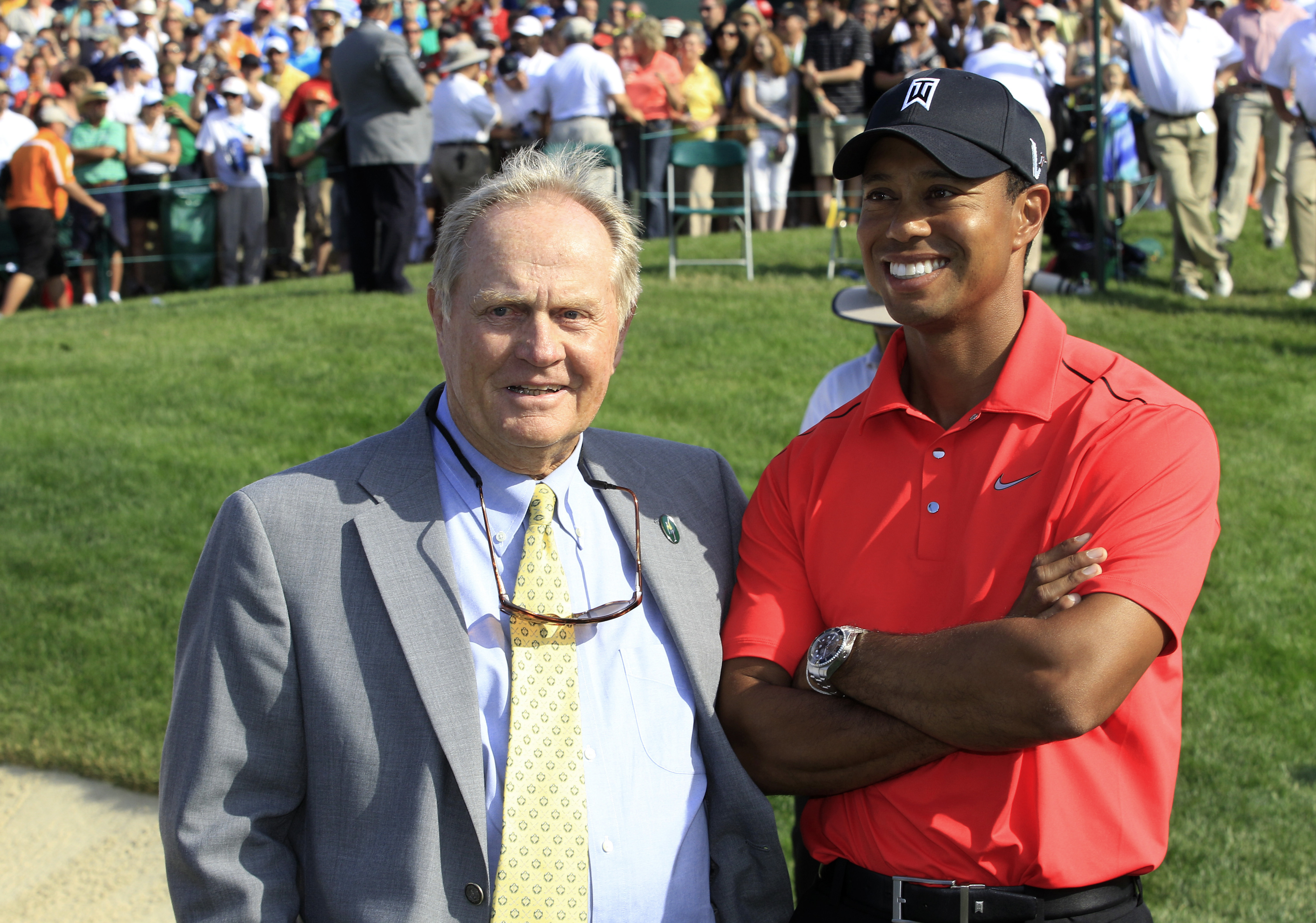 """File-This June 3, 2012, file photo shows Jack Nicklaus, left, and Tiger Woods talking after Woods won the Memorial golf tournament at the Muirfield Village Golf Club in Dublin, Ohio.  Nicklaus says he was """"painting a picture"""" when he suggested after a pra"""