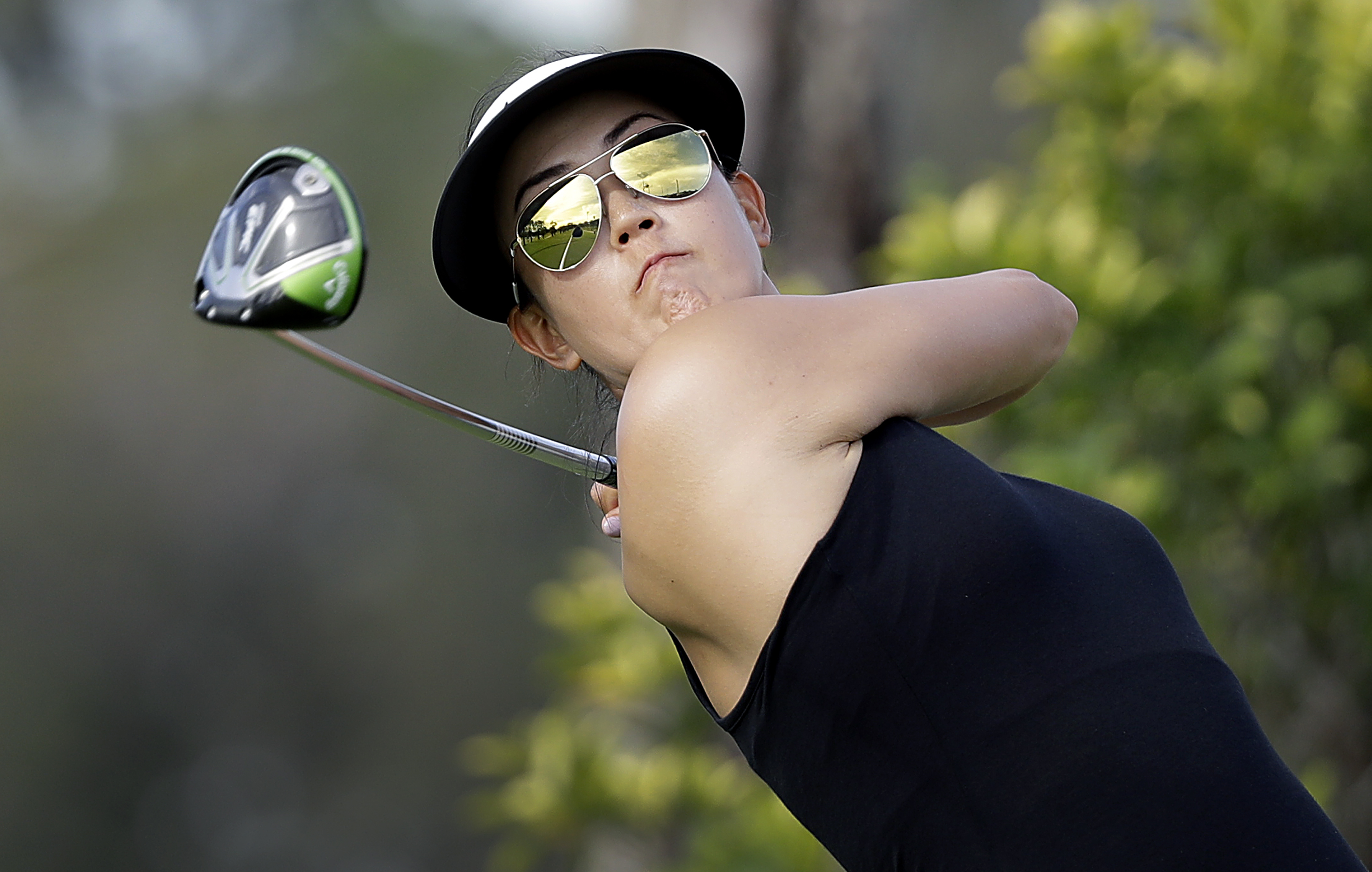 Michelle Wie tees off on the 3rd hole during the first round of the HSBC Women's Champions Thursday.