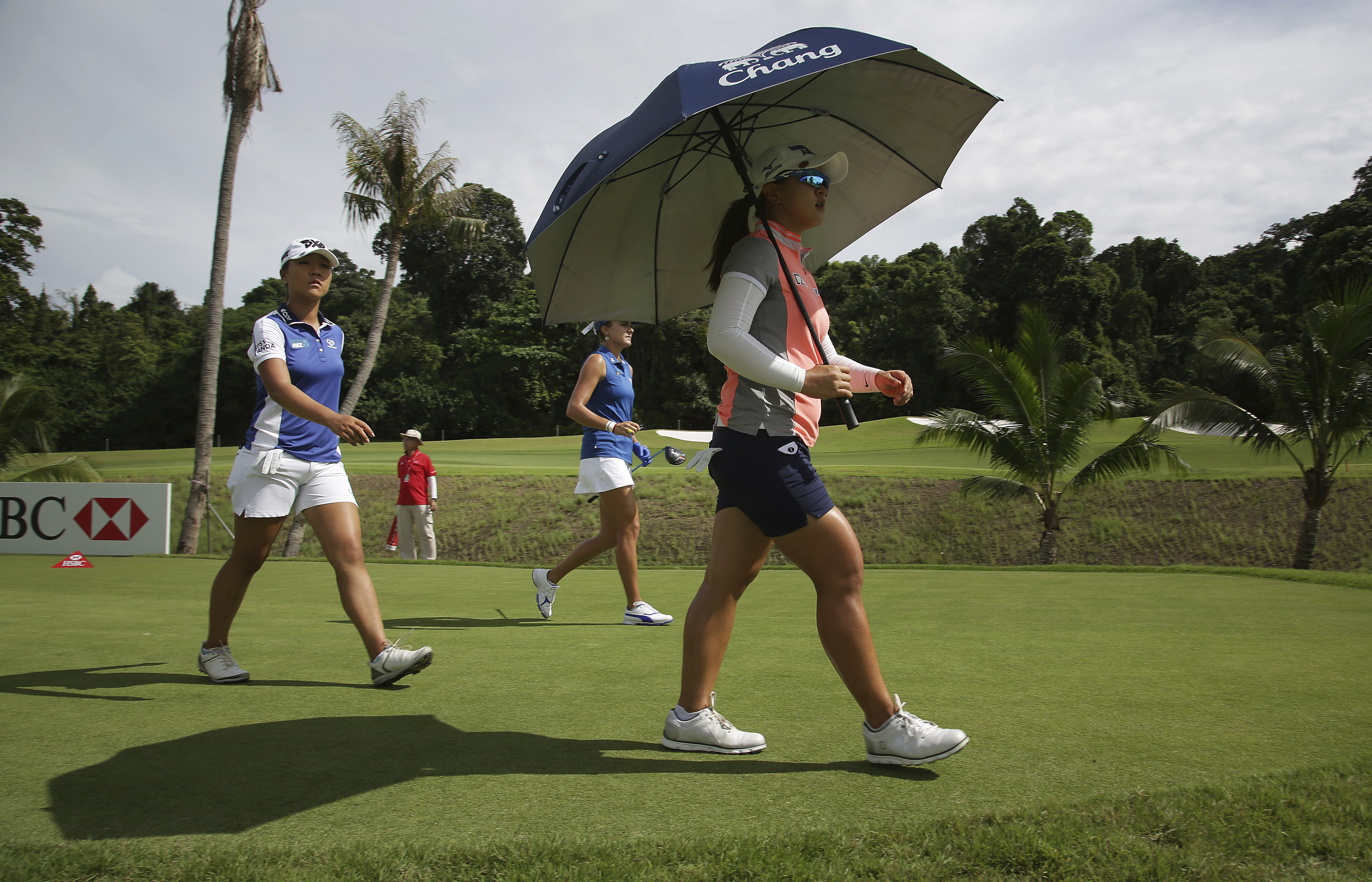 Golfers Lydia Ko of New Zealand, left, Sei Young Kim of South Korea, right, and Lexi Thompson of the United States, center, walk on the third hole during the HSBC Women's Champions golf tournament held at Sentosa Golf Club's Tanjong course on Thursday, Ma