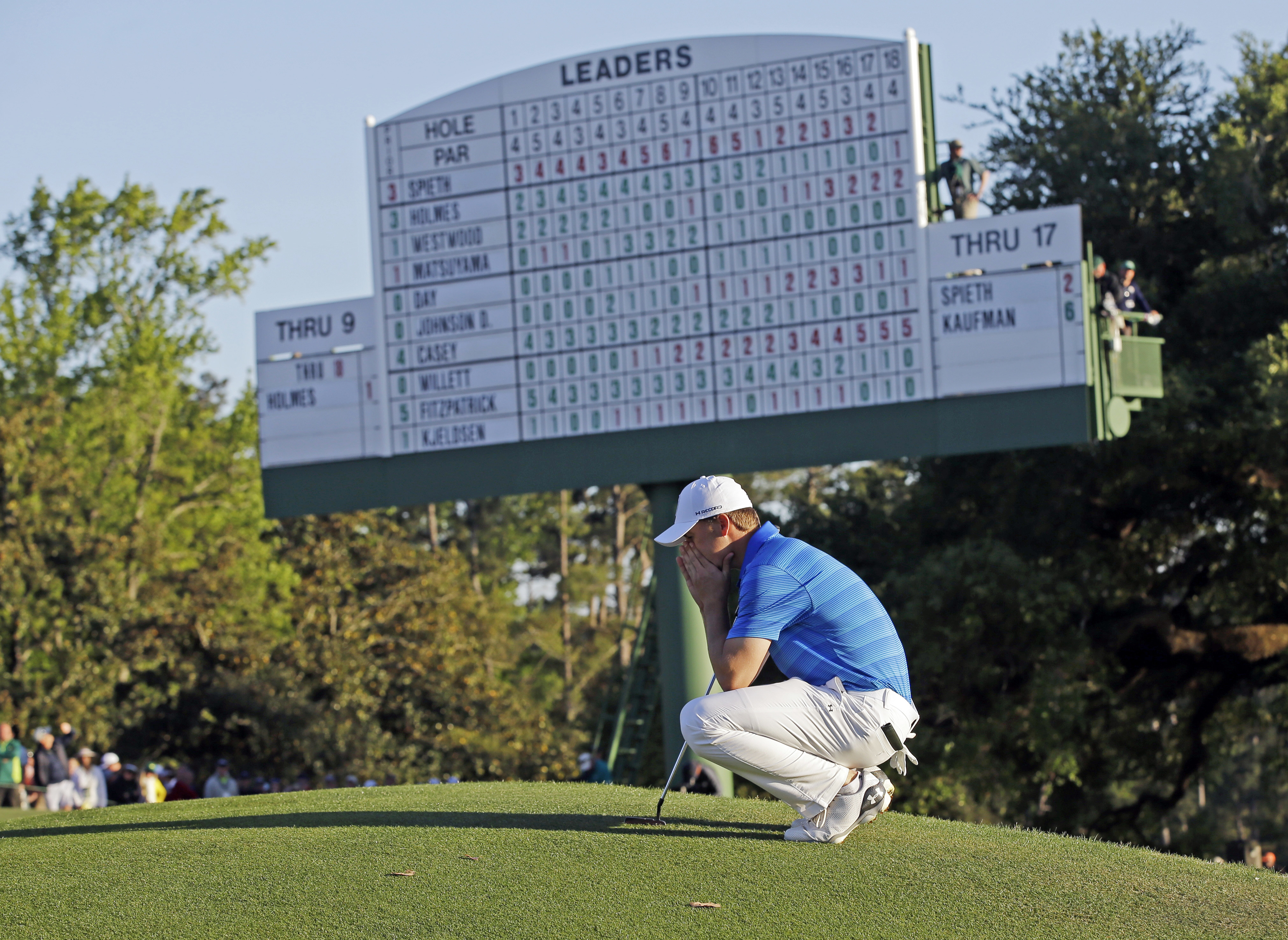 FILE - In this April 10, 2016, file photo, Jordan Spieth waits to putt at the 18th green during the final round of the Masters golf tournament in Augusta, Ga. Two weeks before the Masters begins, Spieth is looking forward to it being over. Spieth was on t