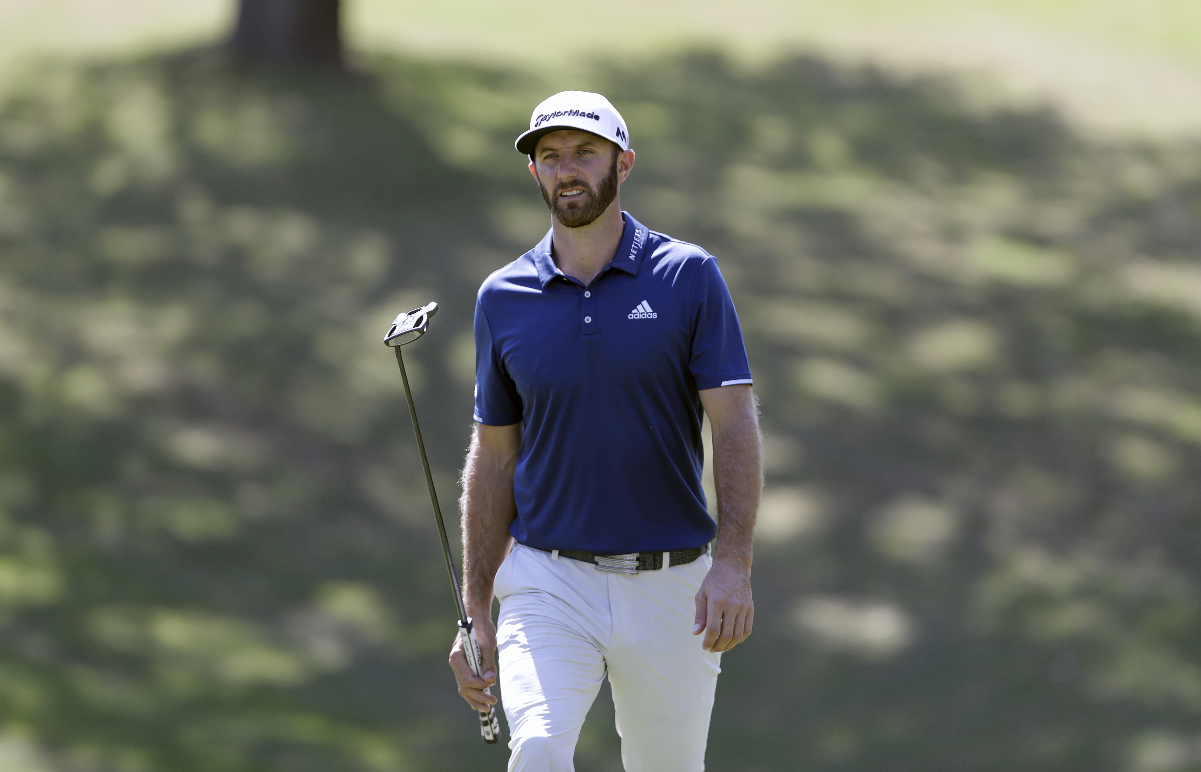 Dustin Johnson walks to the 18th green during a practice round for the Dell Match Play Championship golf tournament at Austin County Club, Tuesday, March 21, 2017, in Austin, Texas. (AP Photo/Eric Gay)