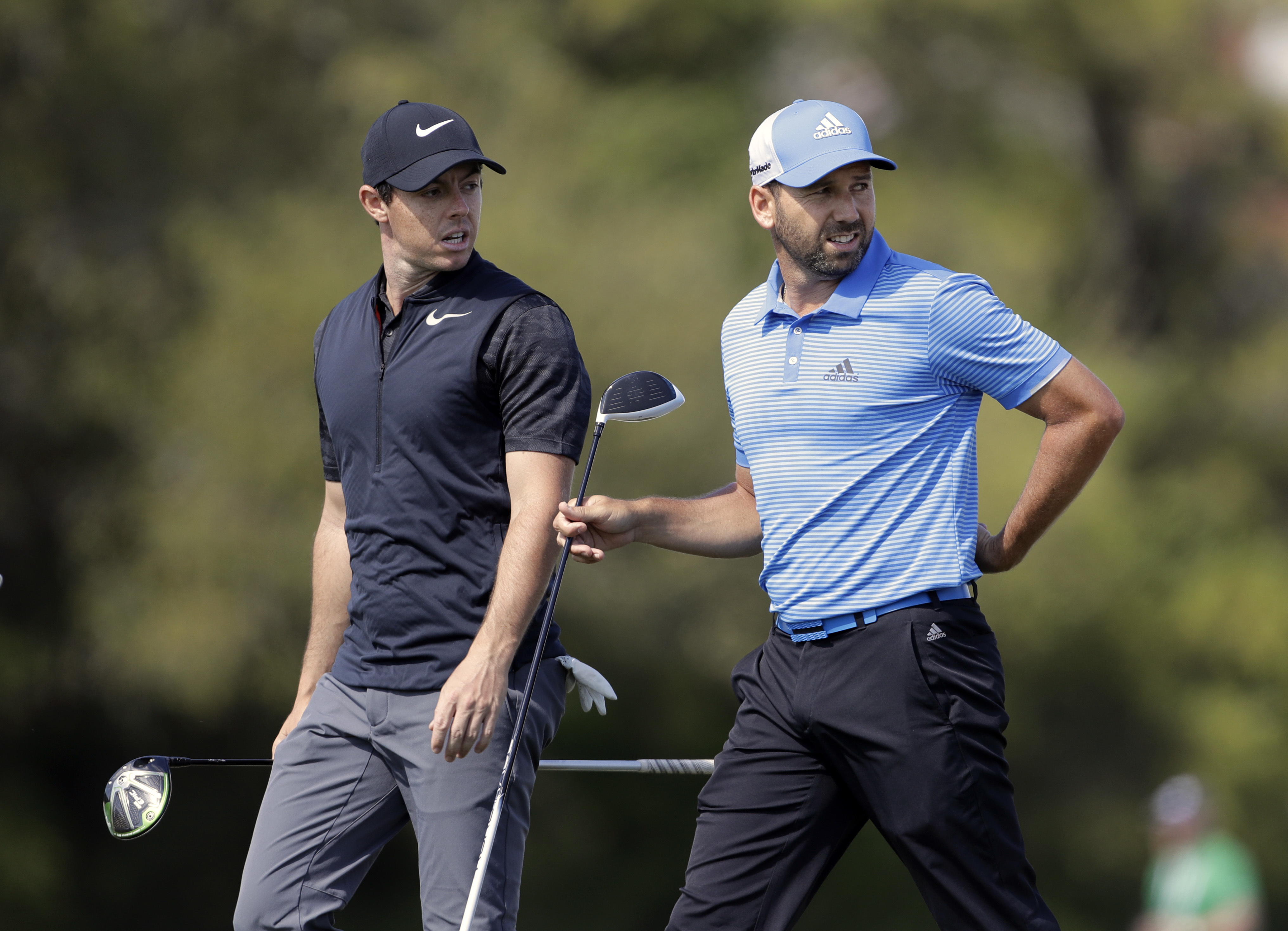 Rory McIlroy, of Northern Ireland, left, and Sergio Garcia, of Spain, walk off the 16th tee during a practice round for the Dell Match Play Championship golf tournament at Austin County Club, Tuesday, March 21, 2017, in Austin, Texas. (AP Photo/Eric Gay)