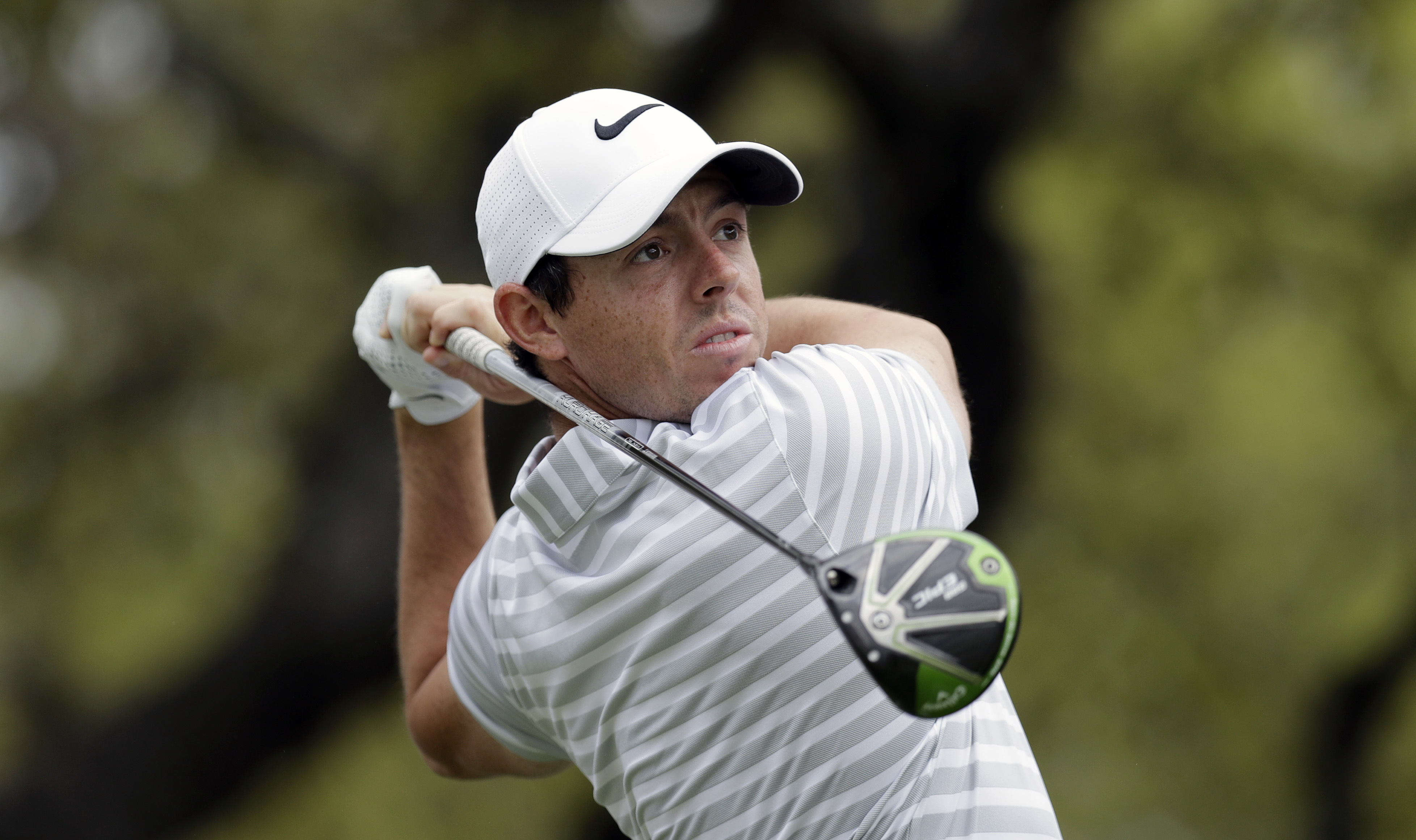 Rory McIlroy, of Northern Ireland, watches his drive on the first hole during round-robin play against Soren Kjeldsen, of Denmark, at the Dell Technologies Match Play golf tournament at Austin County Club, Wednesday, March 22, 2017, in Austin, Texas. (AP