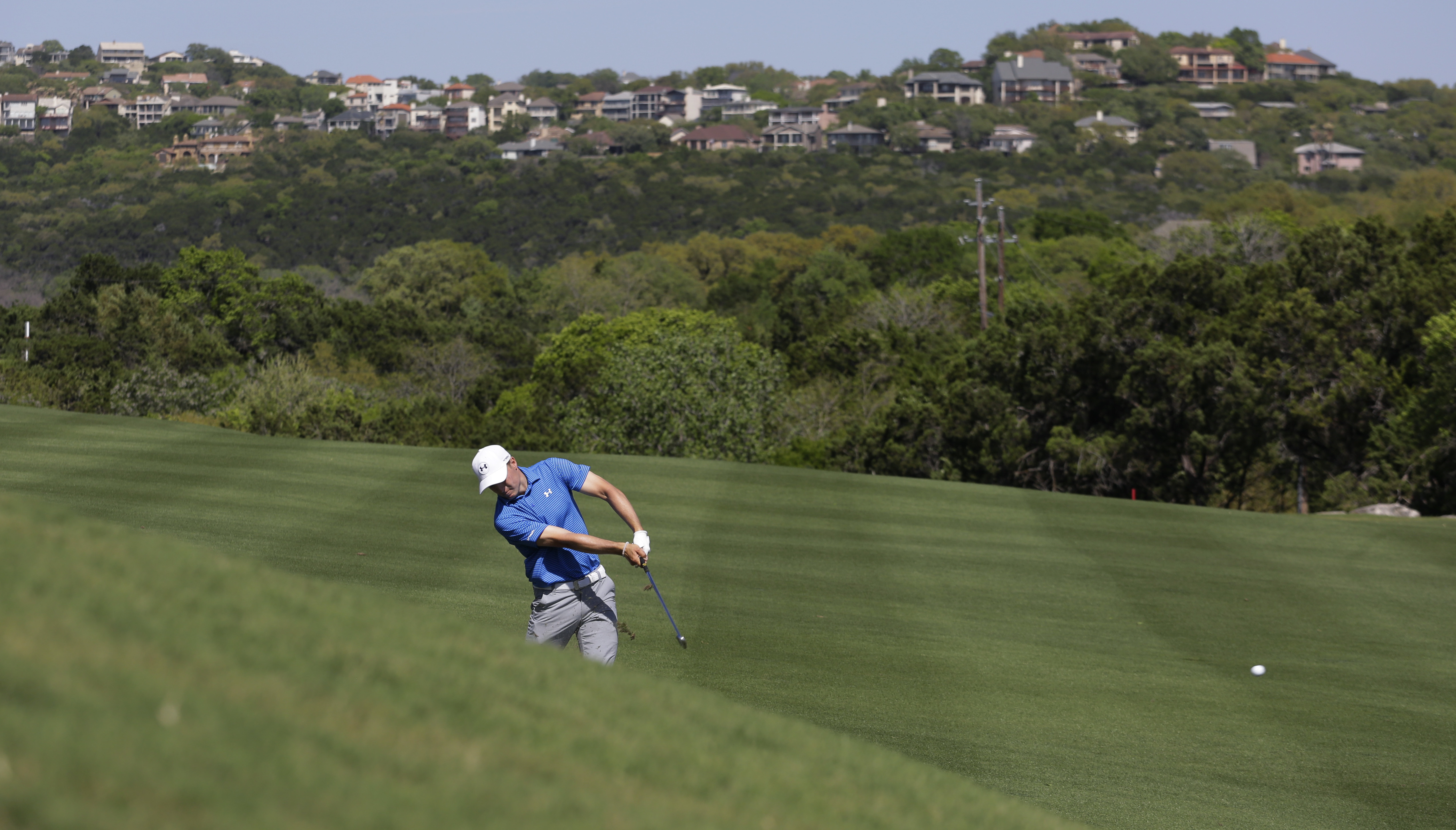 Jordan Spieth hits on the second hole during round-robin play at the Dell Technologies Match Play golf tournament at Austin County Club, Thursday, March 23, 2017, in Austin, Texas. (AP Photo/Eric Gay)