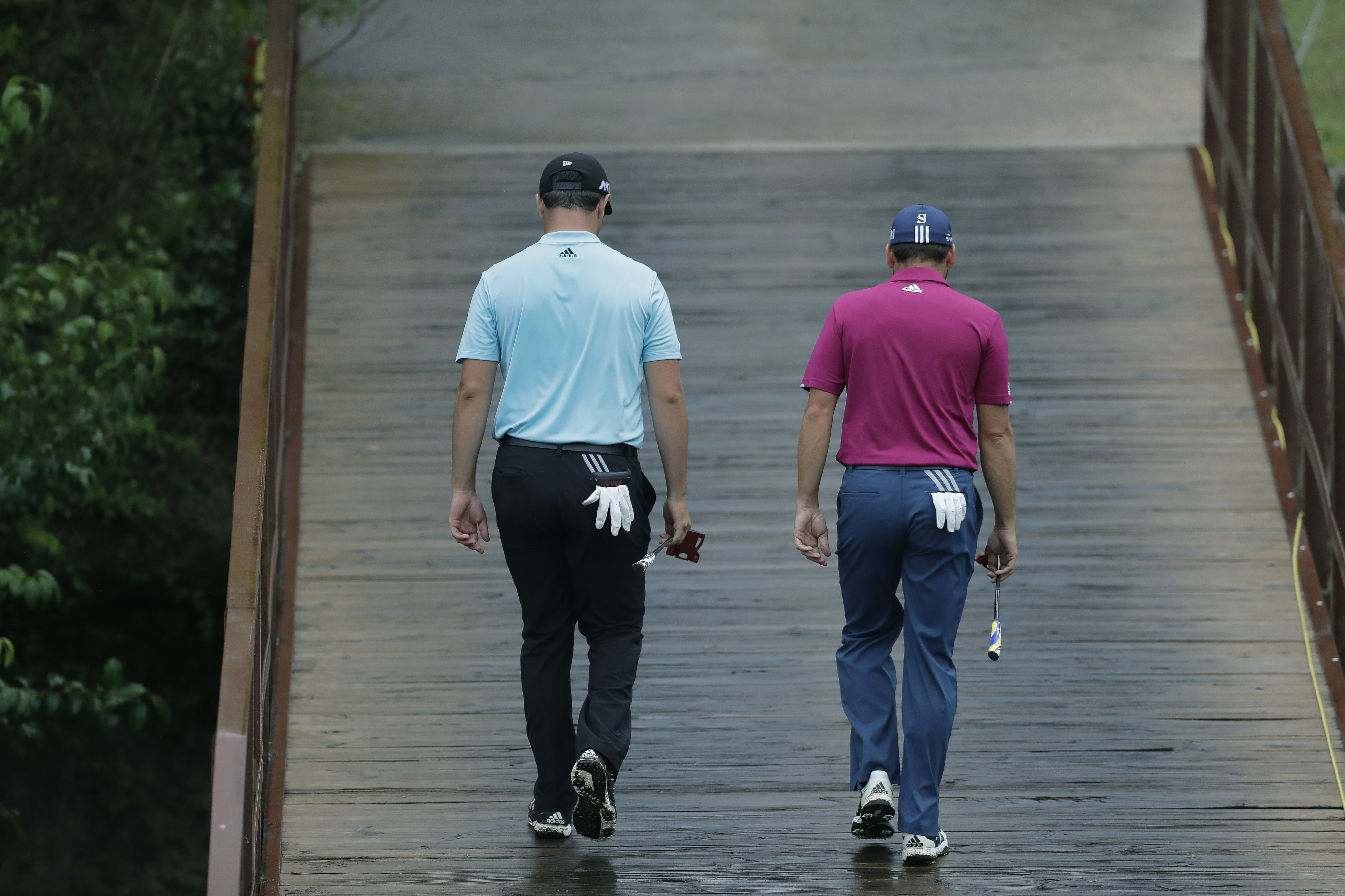 Sergio Garcia, of Spain, right, walks with compatriot and playing partner Jon Rahm on the third hole during round-robin play at the Dell Technologies Match Play golf tournament at Austin County Club, Friday, March 24, 2017, in Austin, Texas. (AP Photo/Eri