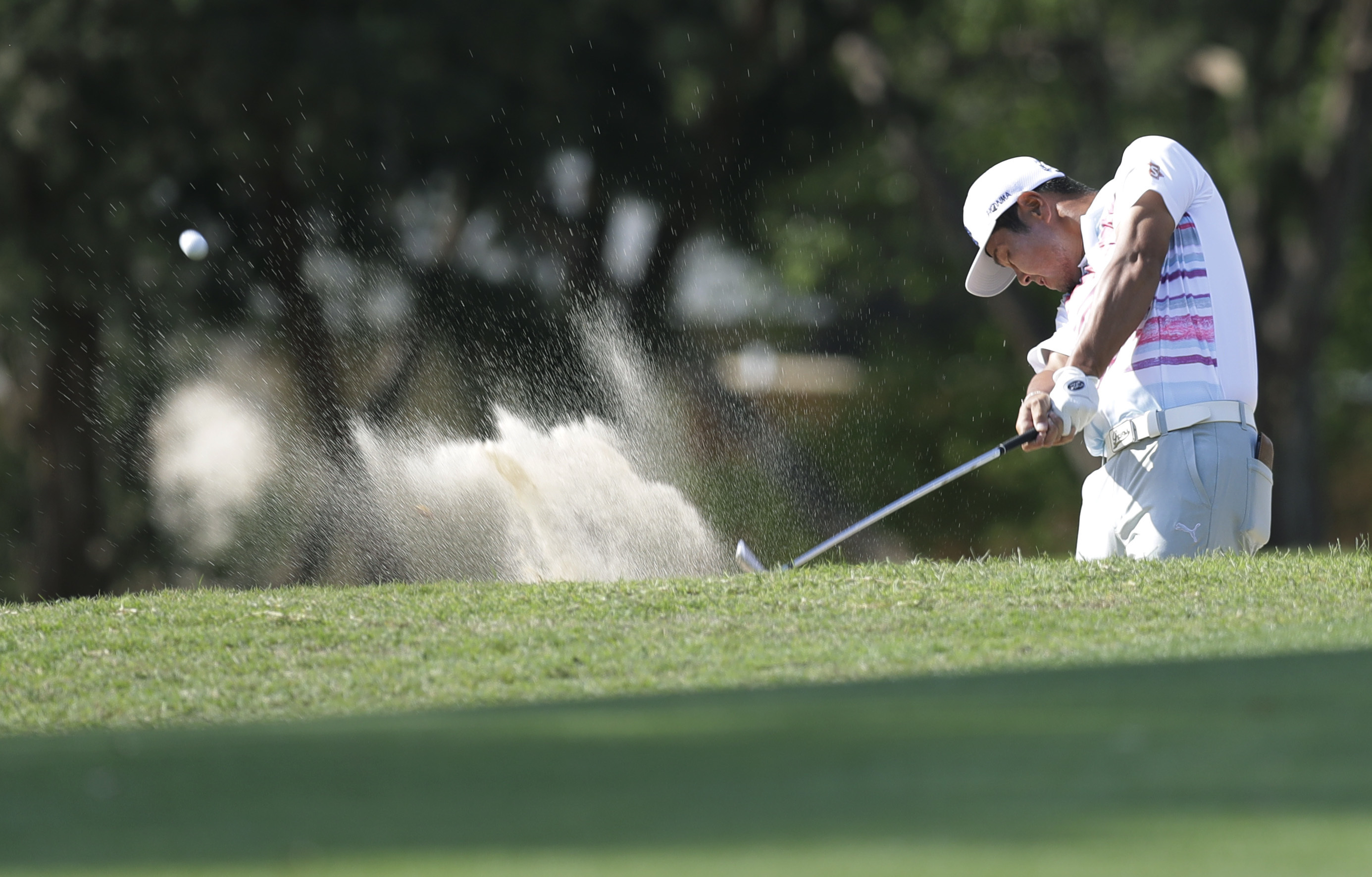 Hideto Tanihara of Japan plays a shot from a bunker on the sixth hole during semifinal play at the Dell Technologies Match Play golf tournament at Austin County Club, Sunday, March 26, 2017, in Austin, Texas. (AP Photo/Eric Gay)