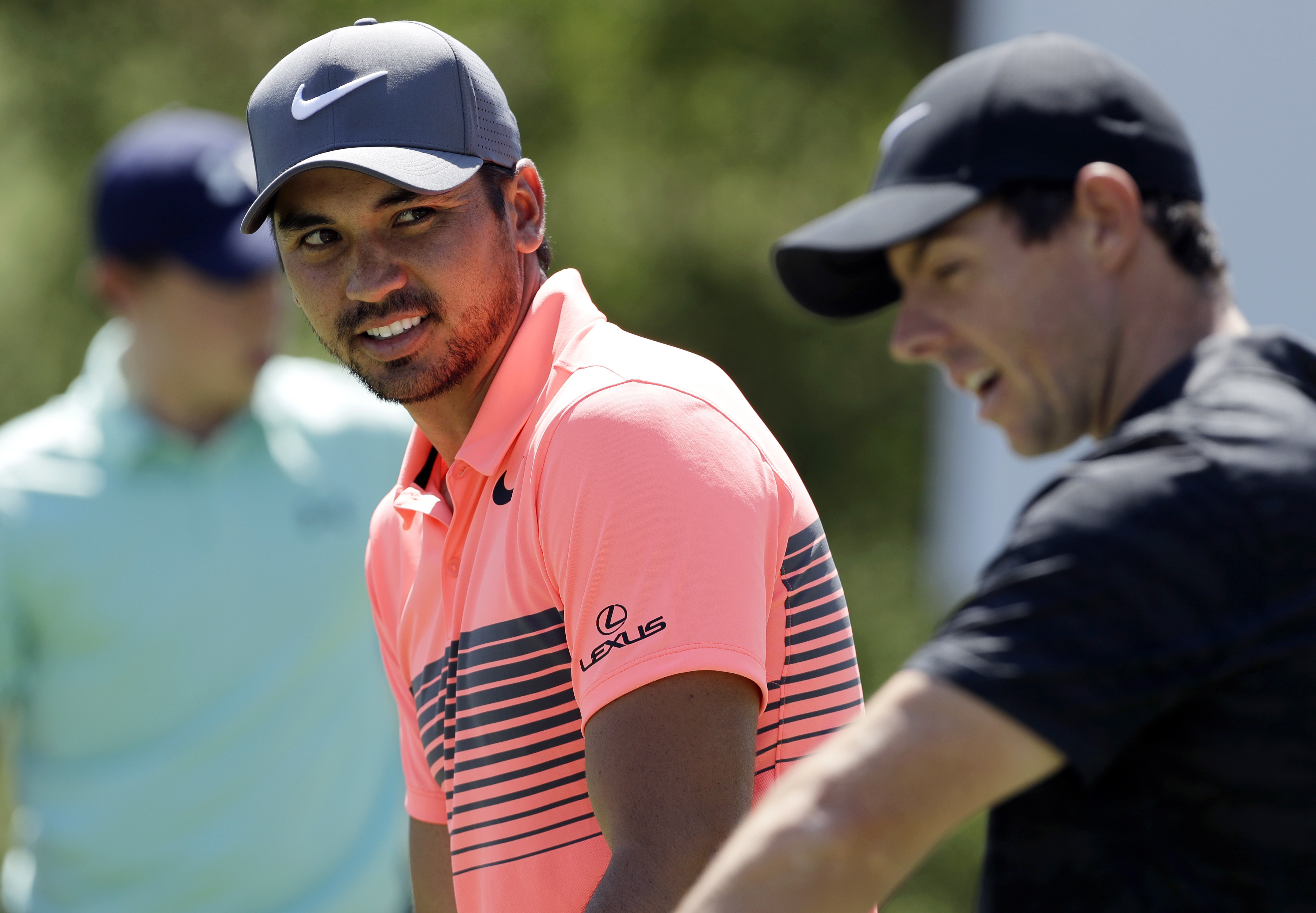 FILE - In this March 21, 2017, file photo, Jason Day, of Australia, left, talks with Rory McIlroy, of Northern Ireland, right, as they practice for the Dell Technologies Match Play Championship golf tournament at Austin County Club in Austin, Texas. (AP P