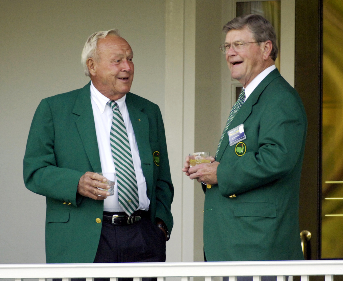 FILE - In this Tuesday, April 4, 2006, file photo, Arnold Palmer, left, and Augusta National Golf Club Chairman Hootie Johnson talk on the veranda of the Augusta National Golf Club, in Augusta, Ga., prior to the annual Masters Champions Dinner. Of all the