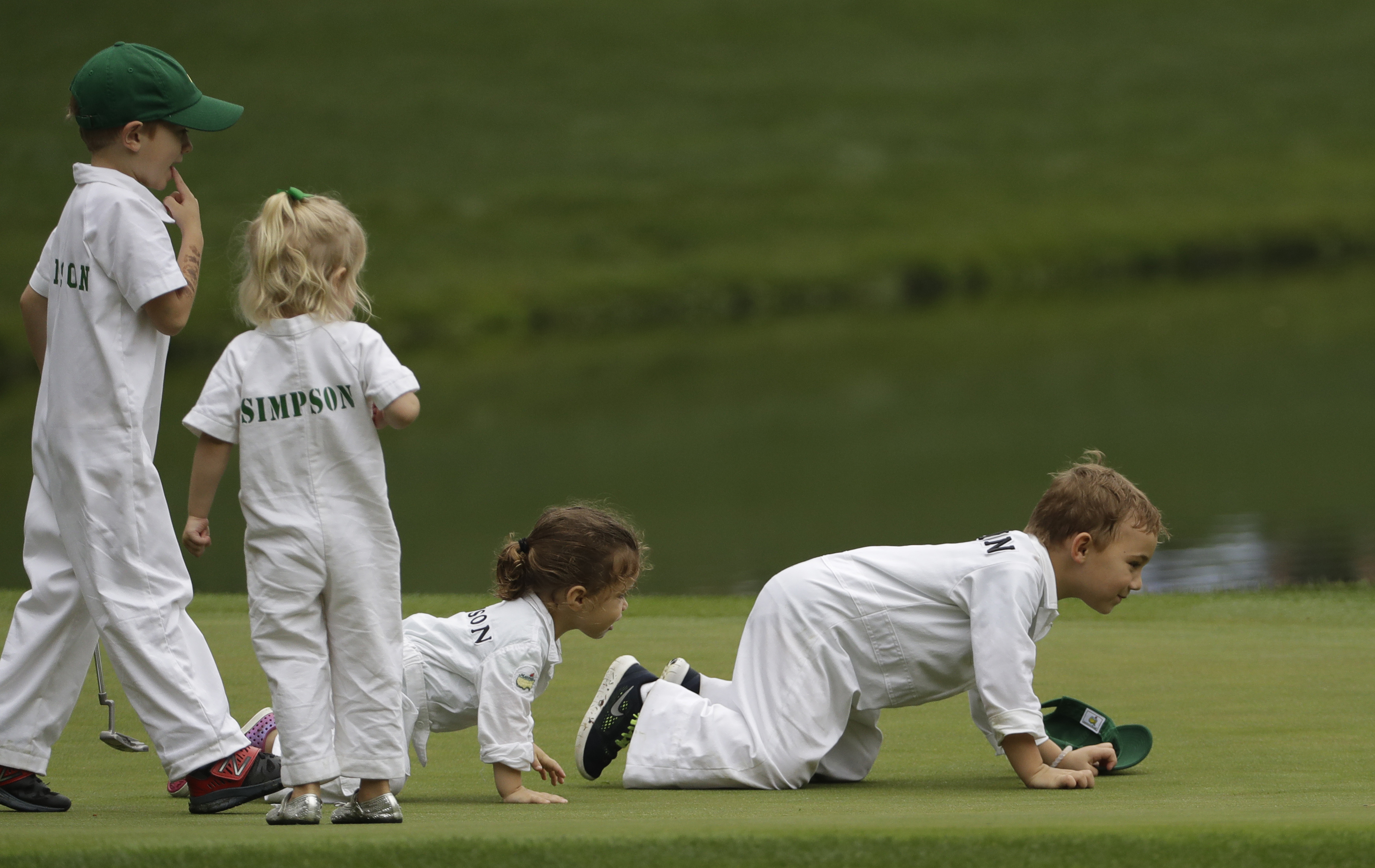 From left, James Simpson, Wyndham Rose Simpson, Dakota Watson and Caleb Watson watch as their fathers Bubba Watson and Webb Simpson play during the par three competition at the Masters golf tournament Wednesday, April 5, 2017, in Augusta, Ga. (AP Photo/Da