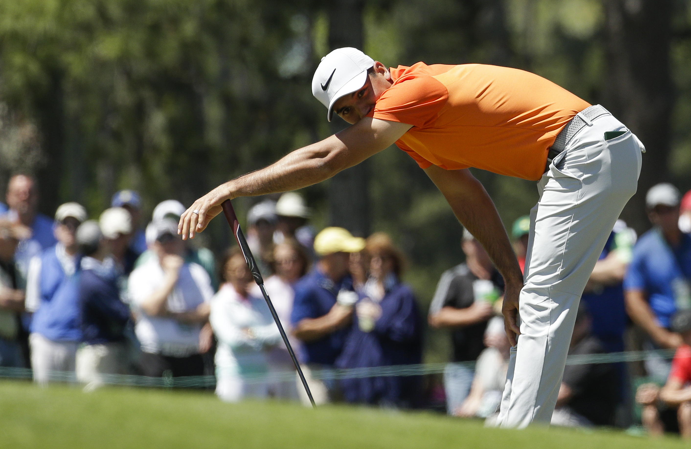 Jason Day of Australia, reacts after missing a putt on the 17th hole during the third round of the Masters golf tournament Saturday, April 8, 2017, in Augusta, Ga. (AP Photo/Charlie Riedel)