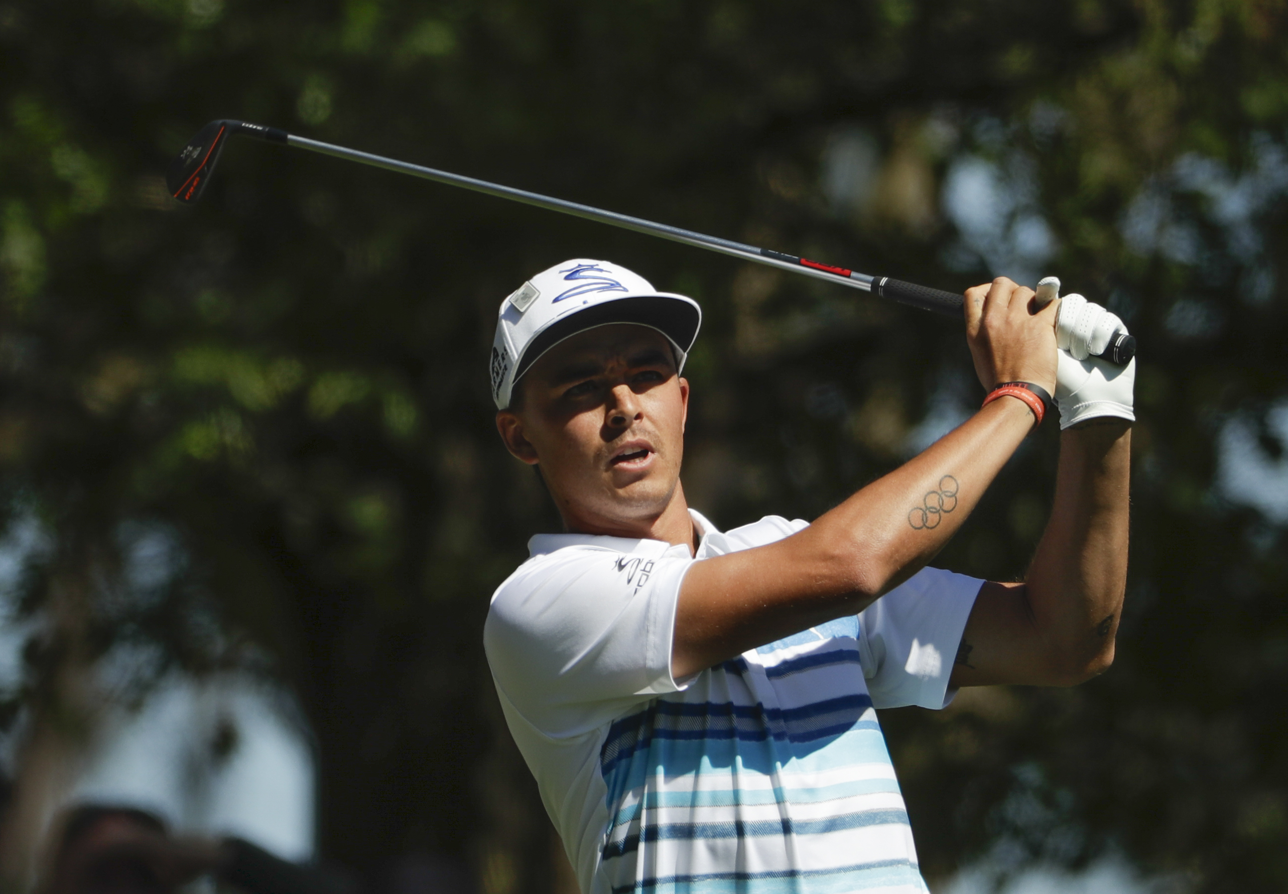 Rickie Fowler hits a drive on the fourth hole during the third round of the Masters golf tournament Saturday, April 8, 2017, in Augusta, Ga. (AP Photo/David Goldman)