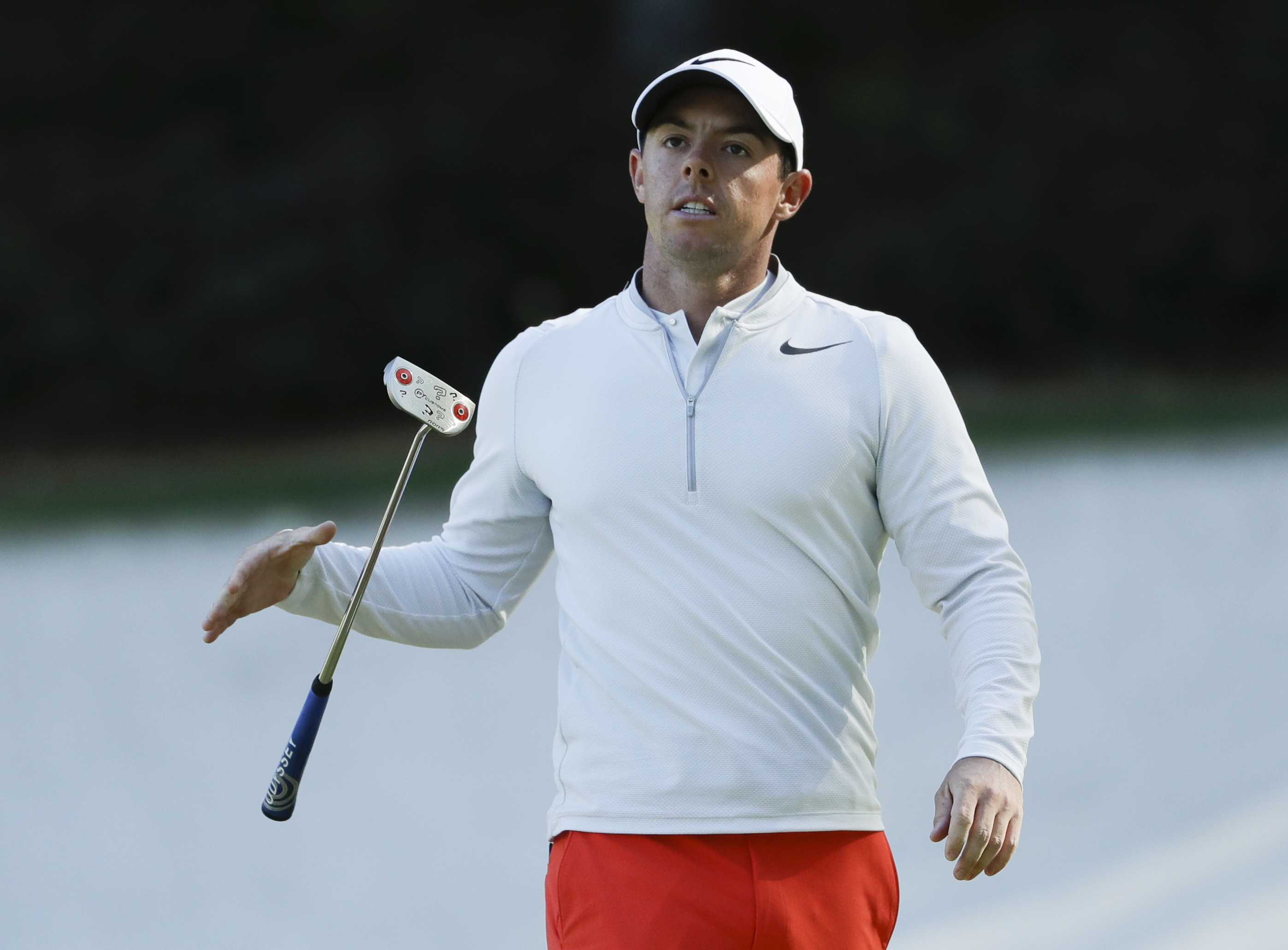 Rory McIlroy of Northern Ireland, drops his putter on the 13th hole during the third round of the Masters golf tournament Saturday, April 8, 2017, in Augusta, Ga. (AP Photo/Matt Slocum)