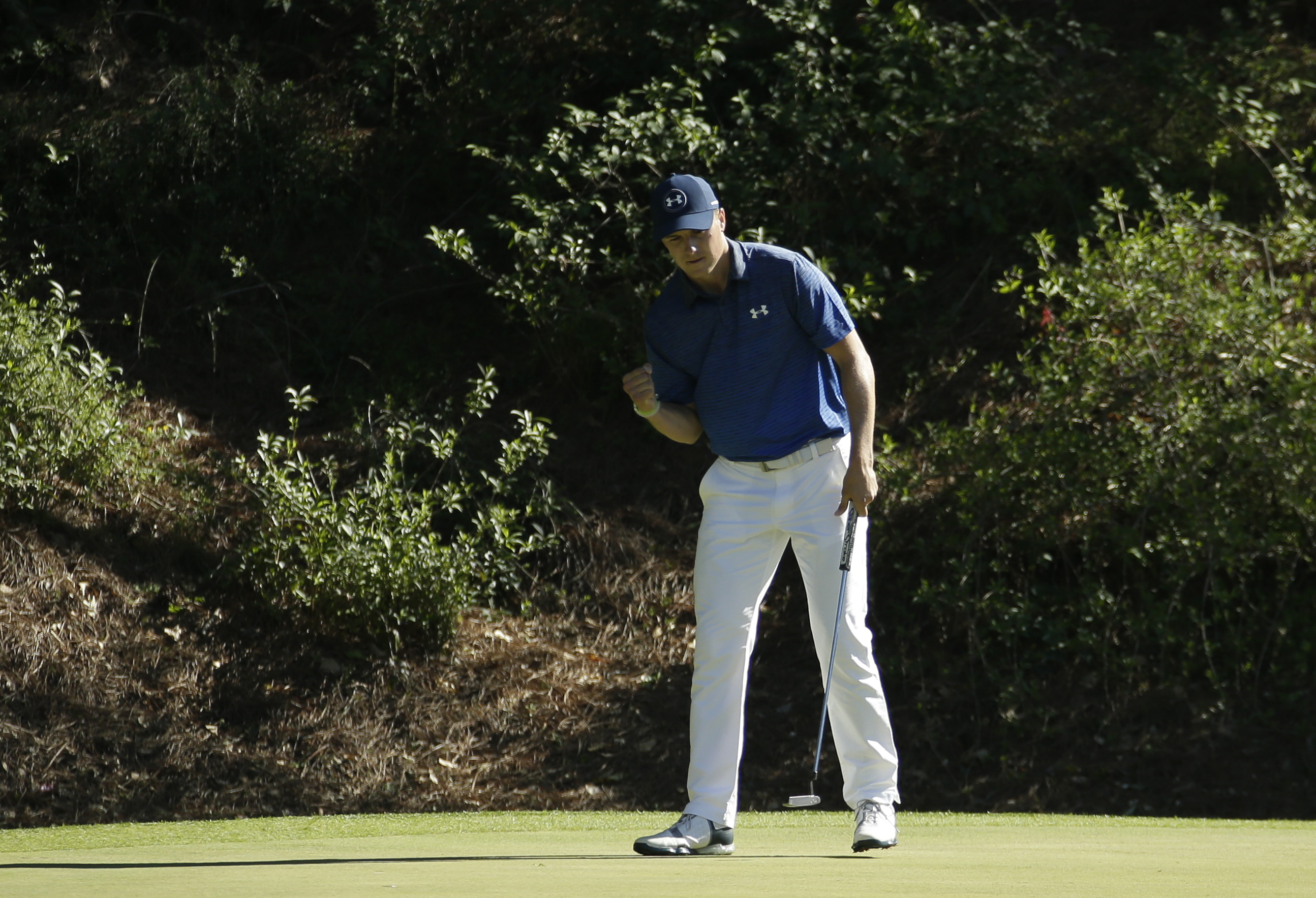 Jordan Spieth reacts to his par saving putt on the 12th hole during the third round of the Masters golf tournament Saturday, April 8, 2017, in Augusta, Ga. (AP Photo/Charlie Riedel)