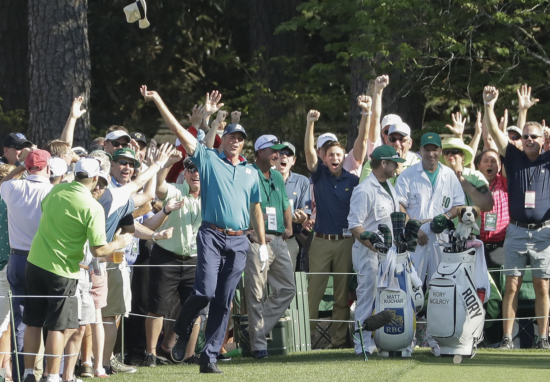 FILE - In this April 9, 2017, file photo, Matt Kuchar reacts after his hole in one on the 16th hole during the final round of the Masters golf tournament, in Augusta, Ga. Kuchar made headlines at the Masters for his Sunday hole in one, his joyous celebrat