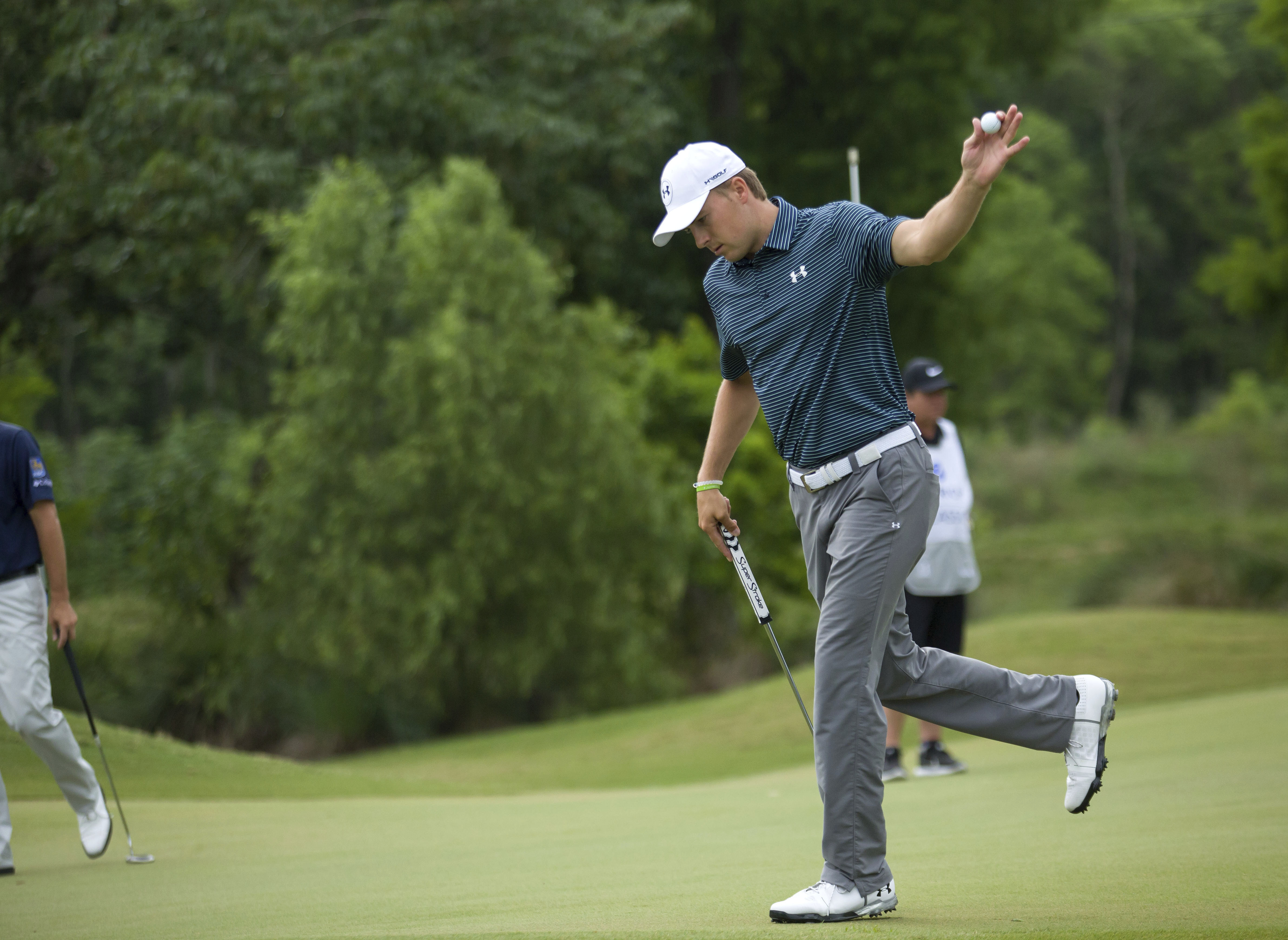 Jordan Spieth shows his ball after sinking a putt on the second hole during the final round of the PGA Zurich Classic golf tournament's new two-man team format at TPC Louisiana in Avondale, La., Sunday, April 30, 2017. (AP Photo/Scott Threlkeld)