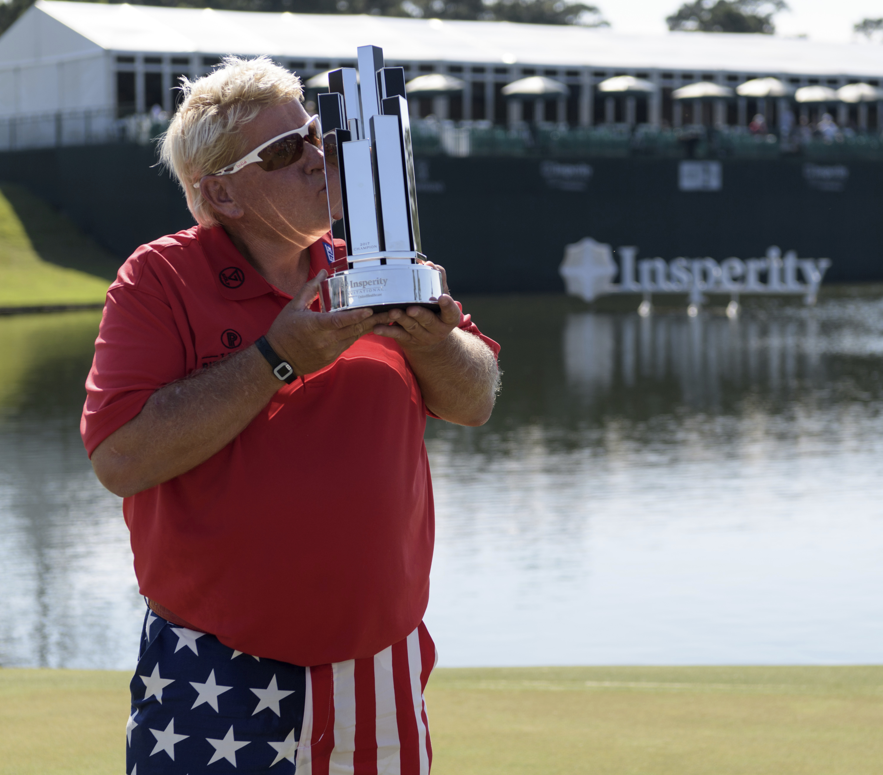 John Daly kisses the trophy after winning the Insperity Invitational golf tournament on Sunday, May 7, 2017, in The Woodlands, Texas. (Wilf Thorne/Houston Chronicle via AP)