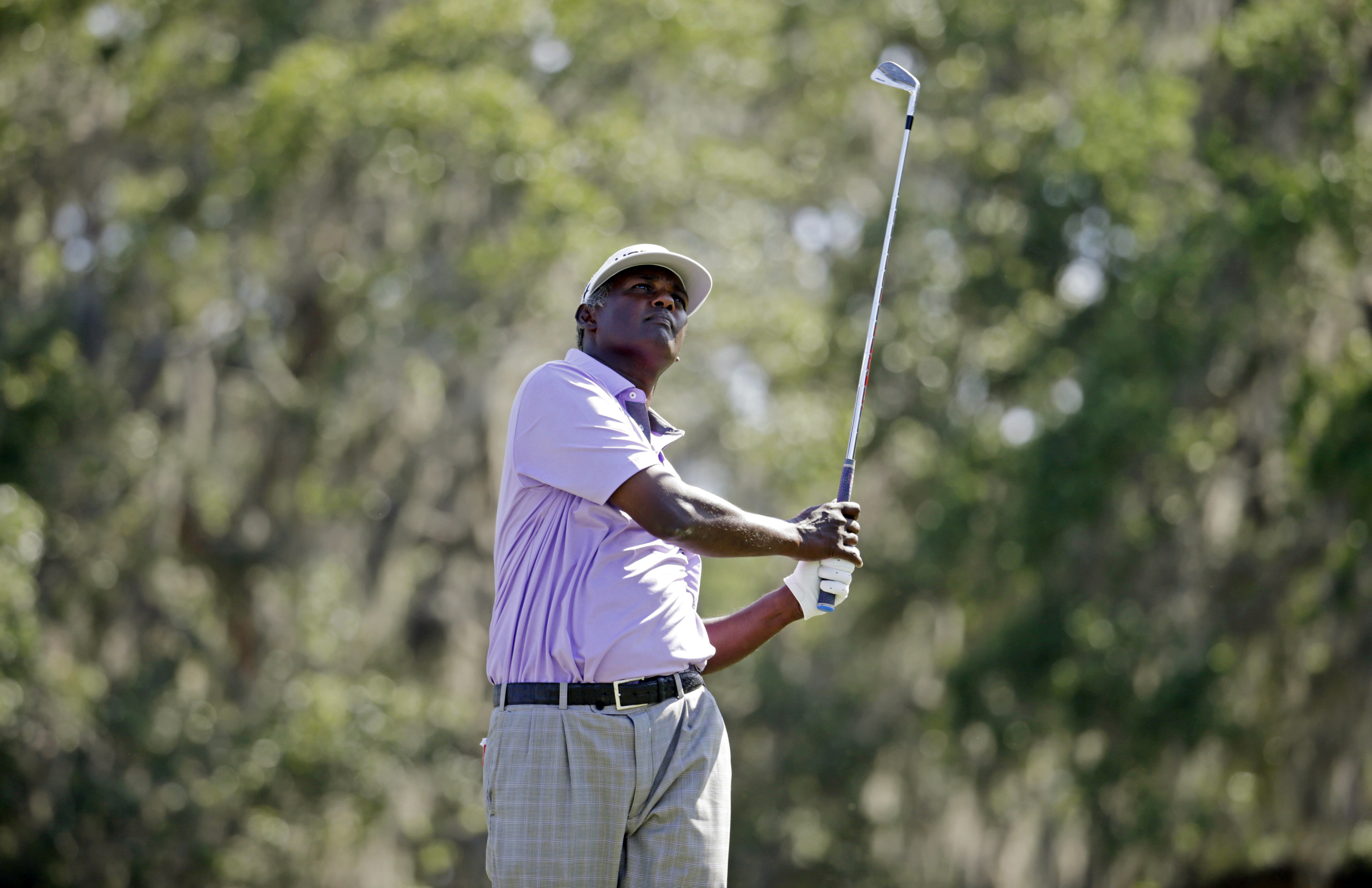 Vijay Singh, of Fiji, watches his shot from the 12th tee during the second round of The Players Championship golf tournament Friday, May 12, 2017, in Ponte Vedra Beach, Fla. (AP Photo/Lynne Sladky)