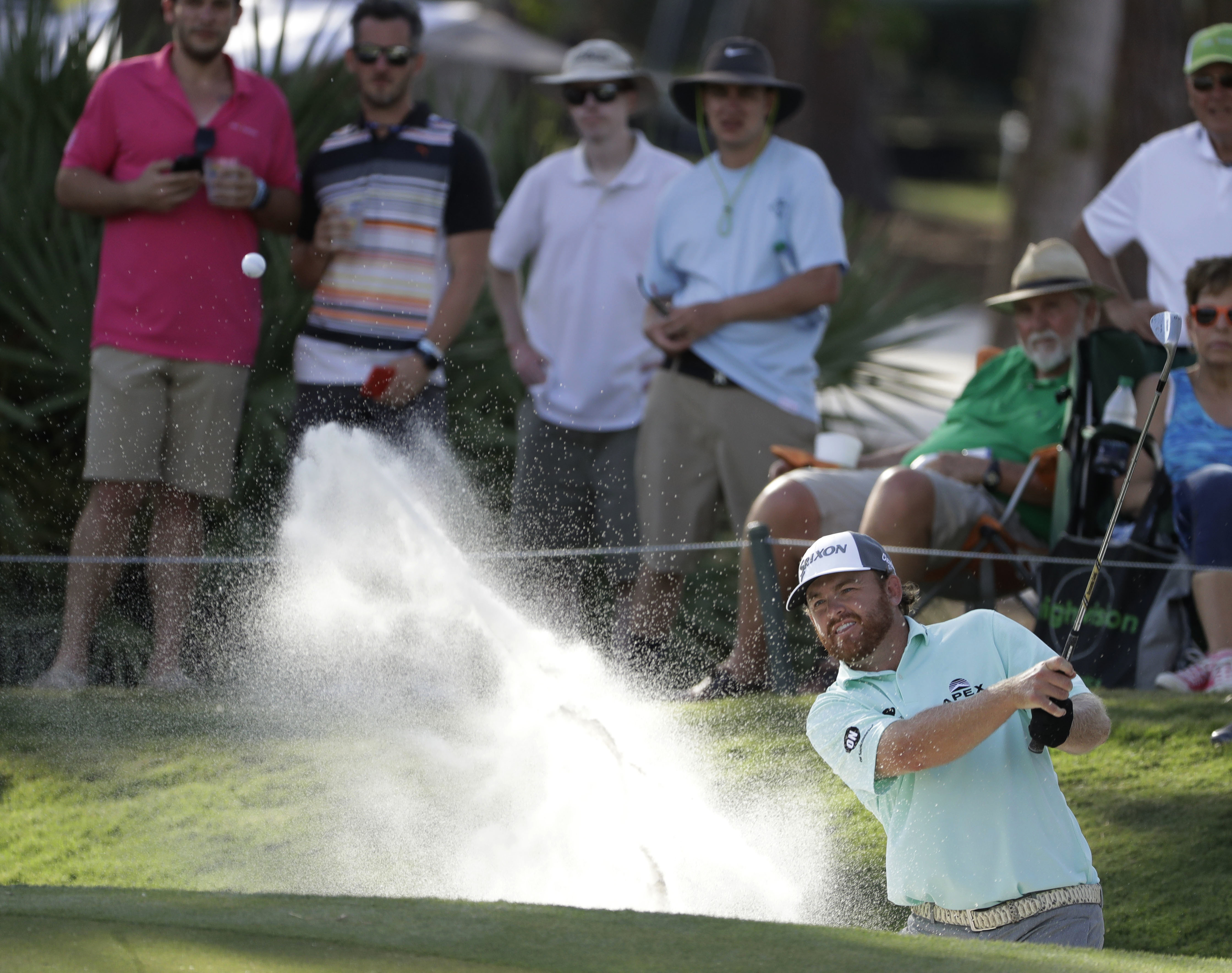 J.B. Holmes hits from a bunker on the eighth hole, during the second round of The Players Championship golf tournament Friday, May 12, 2017, in Ponte Vedra Beach, Fla. (AP Photo/Chris O'Meara)