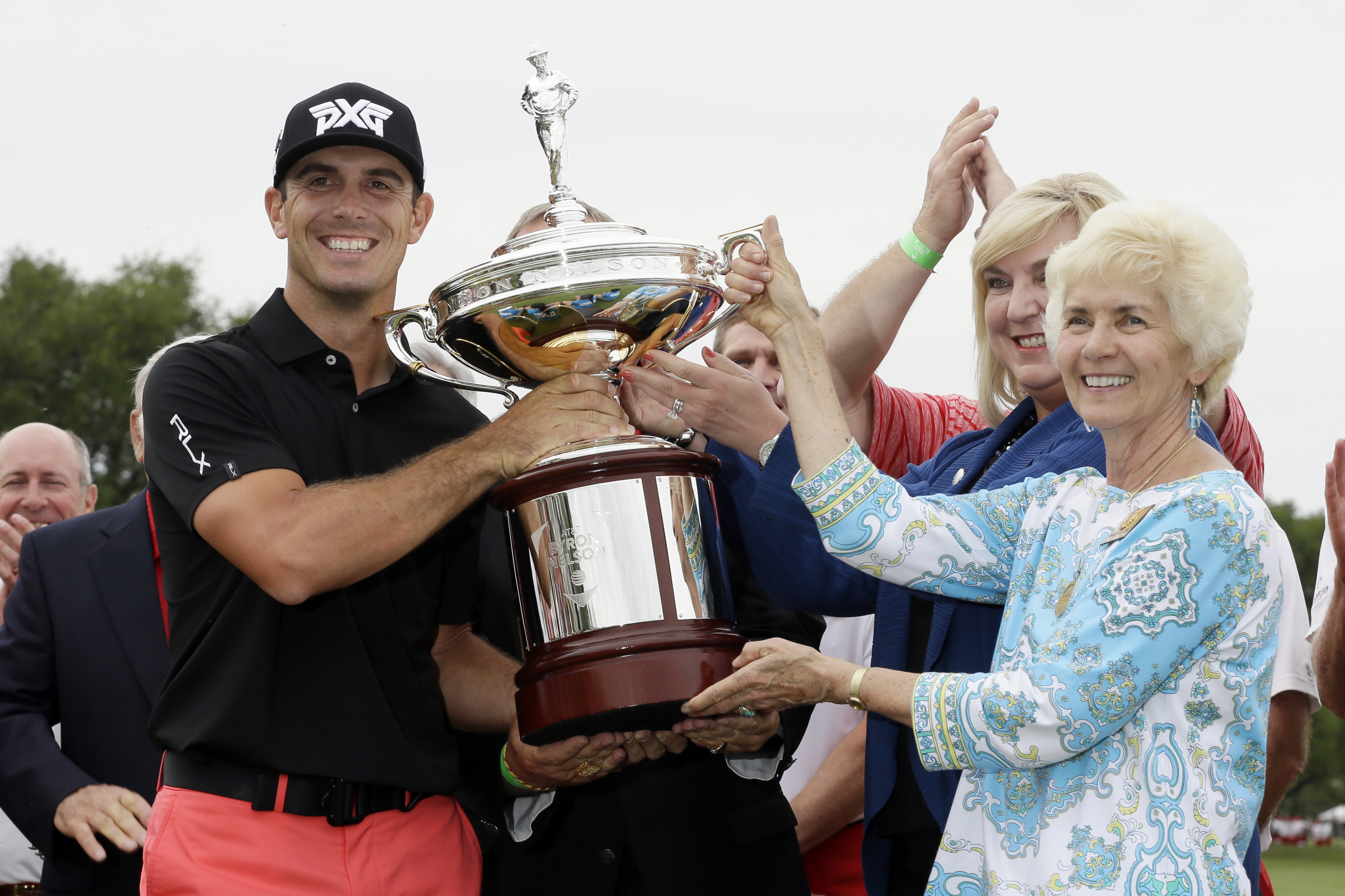 Billy Horschel is awarded the tournament trophy by Peggy Nelson, widow of Byron Nelson after Horschel's win in the Byron Nelson golf tournament, Sunday, May 21, 2017, in Irving, Texas. (AP Photo/Tony Gutierrez)